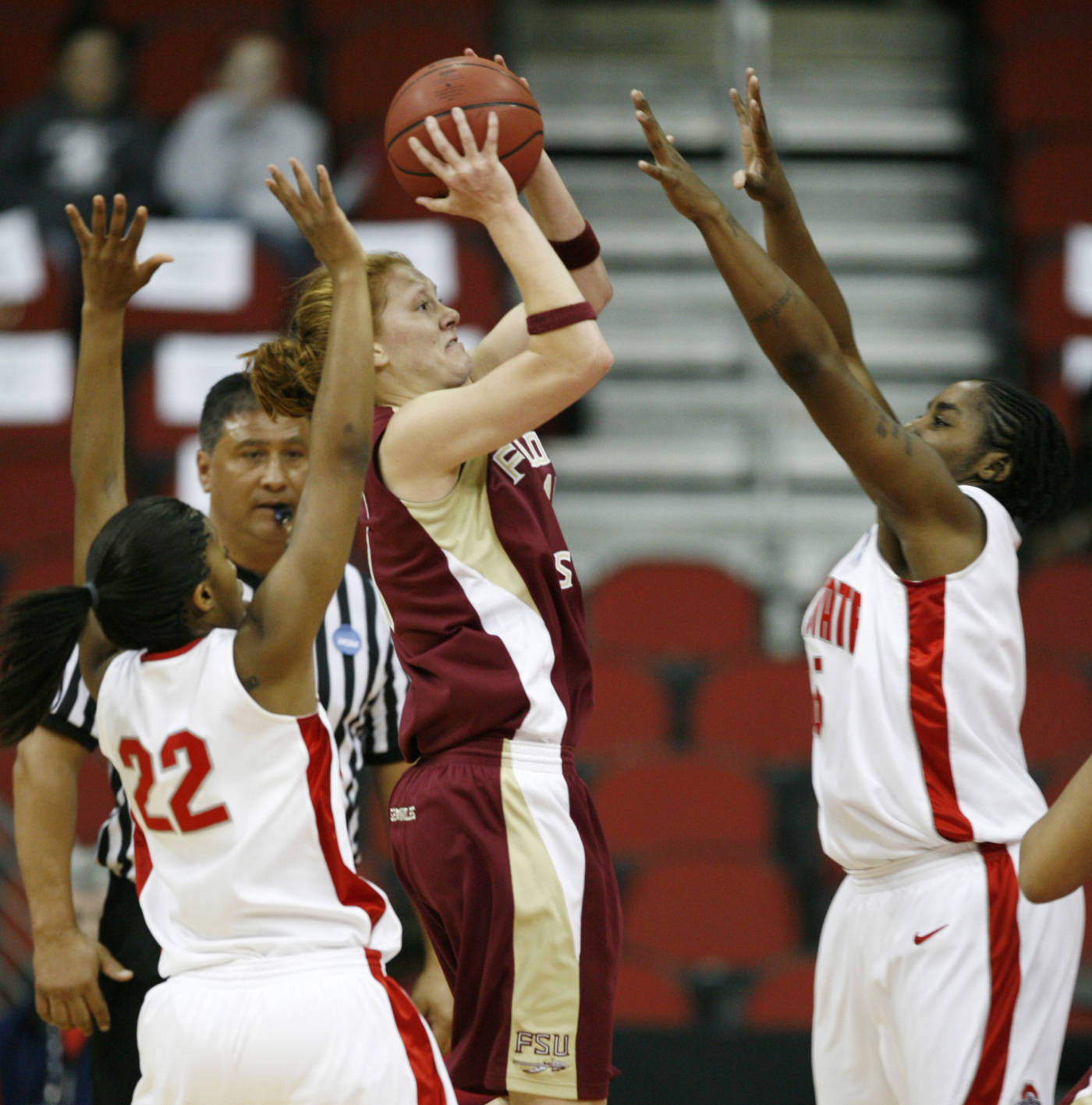 Florida State's Mara Freshour shoots between Ohio State's Marscilla Packer and Star Allen  during the first half. (AP Photo/Charlie Neibergall)