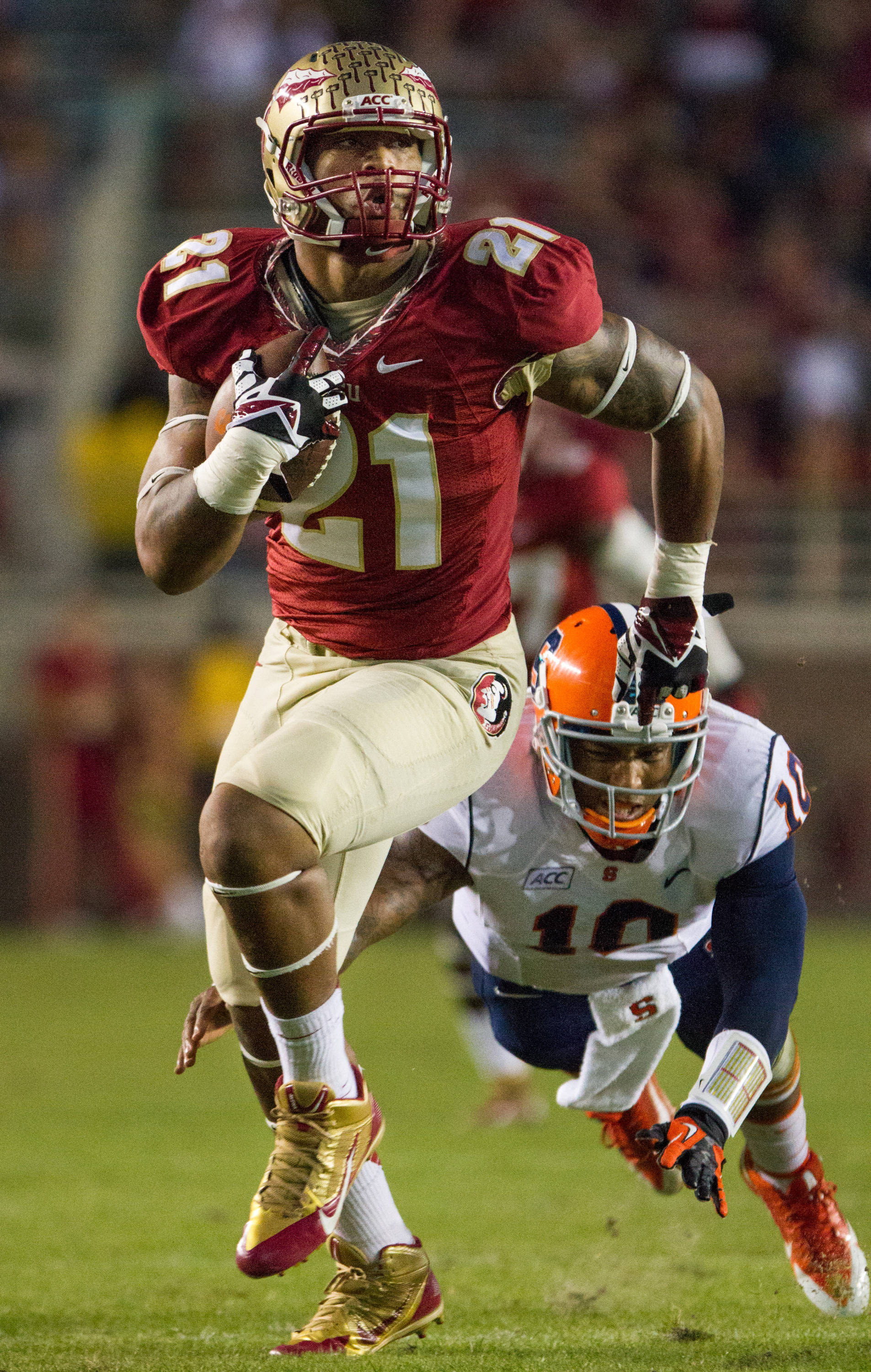 Chris Casher (21) runs in a recovered fumble for a touchdown during FSU Football's 59-3 win over Syracuse on Saturday, November 16, 2013 in Tallahassee, Fla. Photo by Mike Schwarz.
