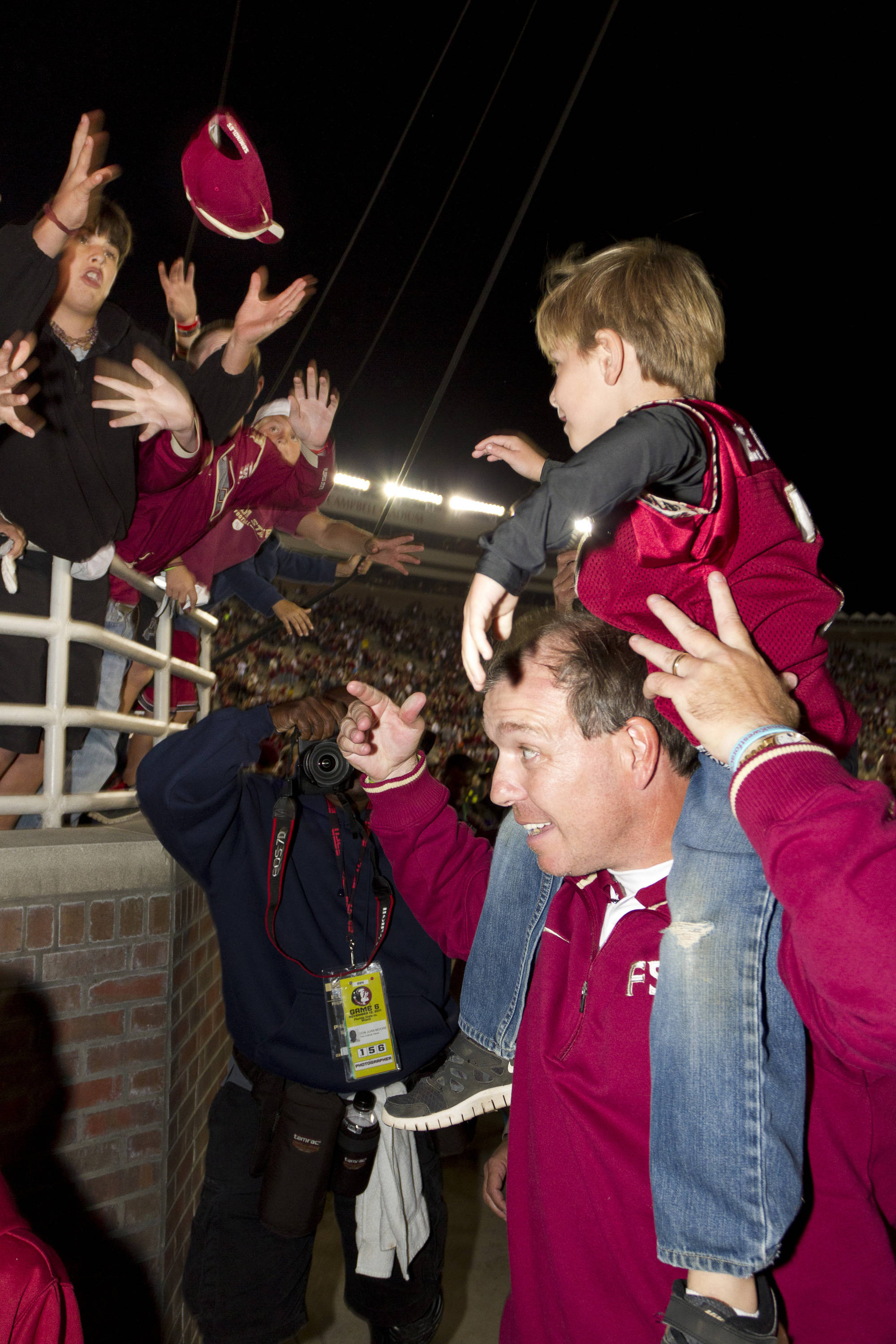 Jimbo Fisher celebrates with son Ethan after the Miami victory on November 12th