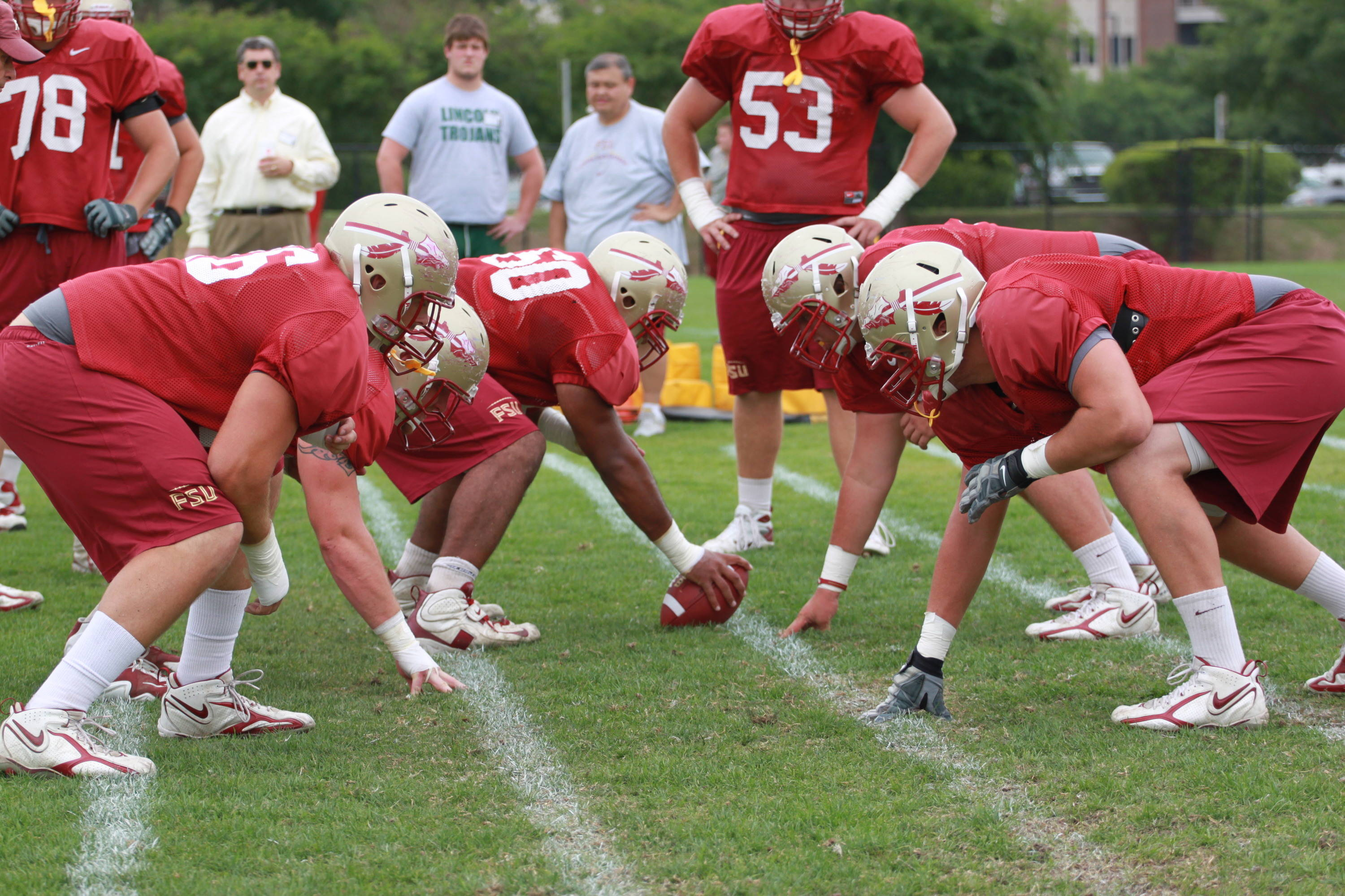 The offensive line getting down to business.