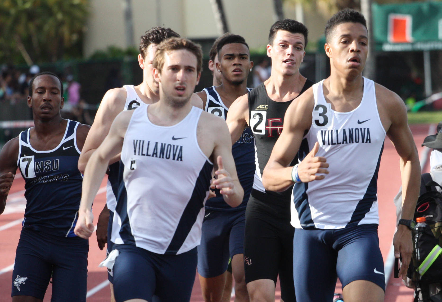 Matt Magee, with tongue out, chasing a Villanova pair in the 800.