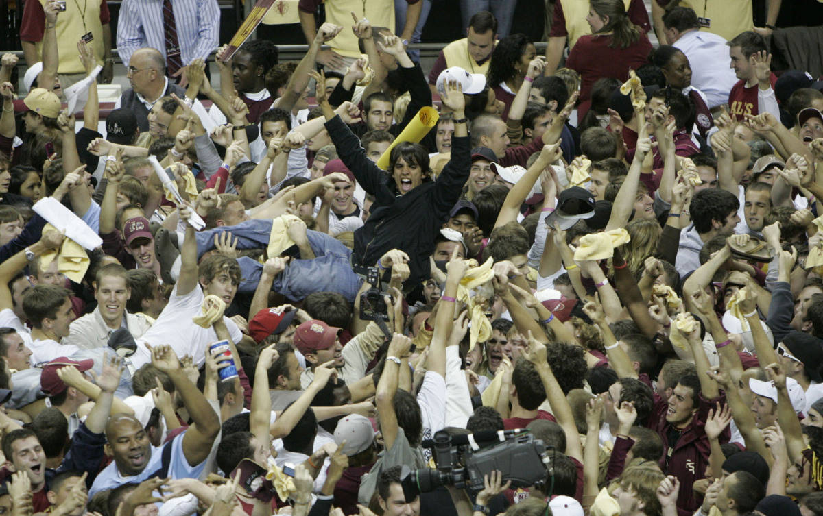 Florida State fans storm the court following the Seminoles 70-66 upset win over Florida, Sunday, Dec. 3, 2006, in Tallahassee, Fla.(AP Photo/Phil Coale)