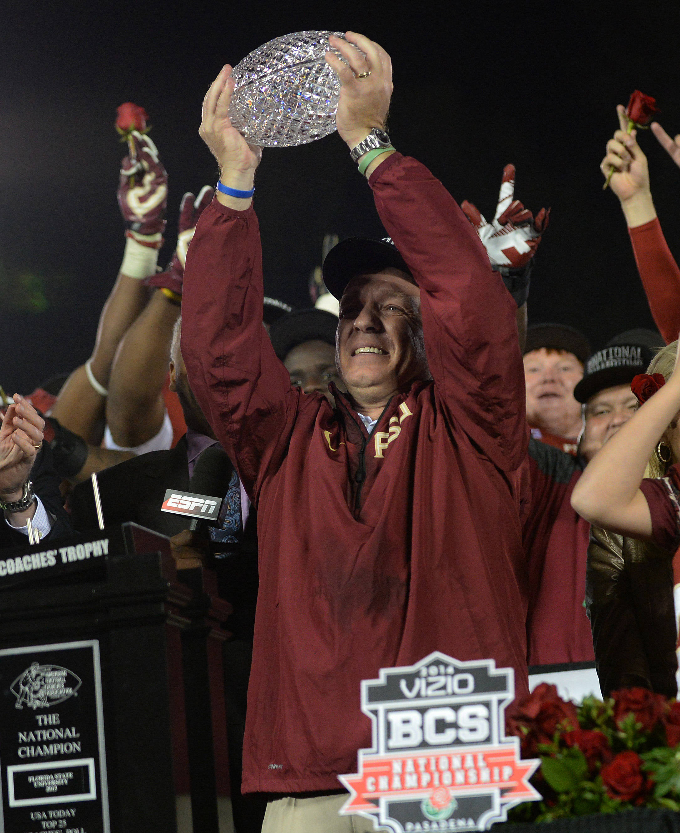 Jimbo Fisher raises the trophy