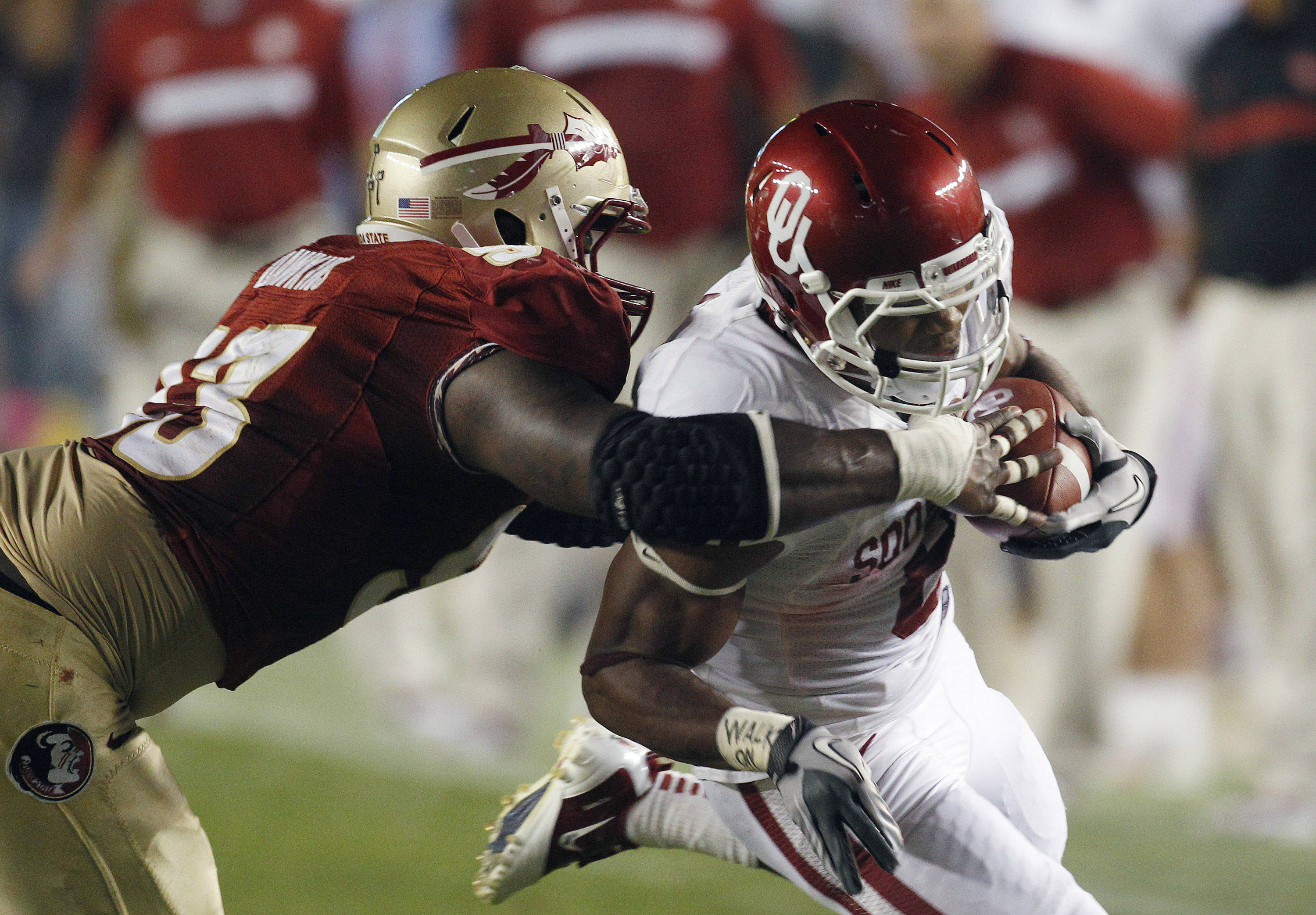Oklahoma running back Dominique Whaley (8) gets shoved out-of-bounds by Florida State defensive tackle Everett Dawkins (93) during the first quarter. (AP Photo/Chris O'Meara)