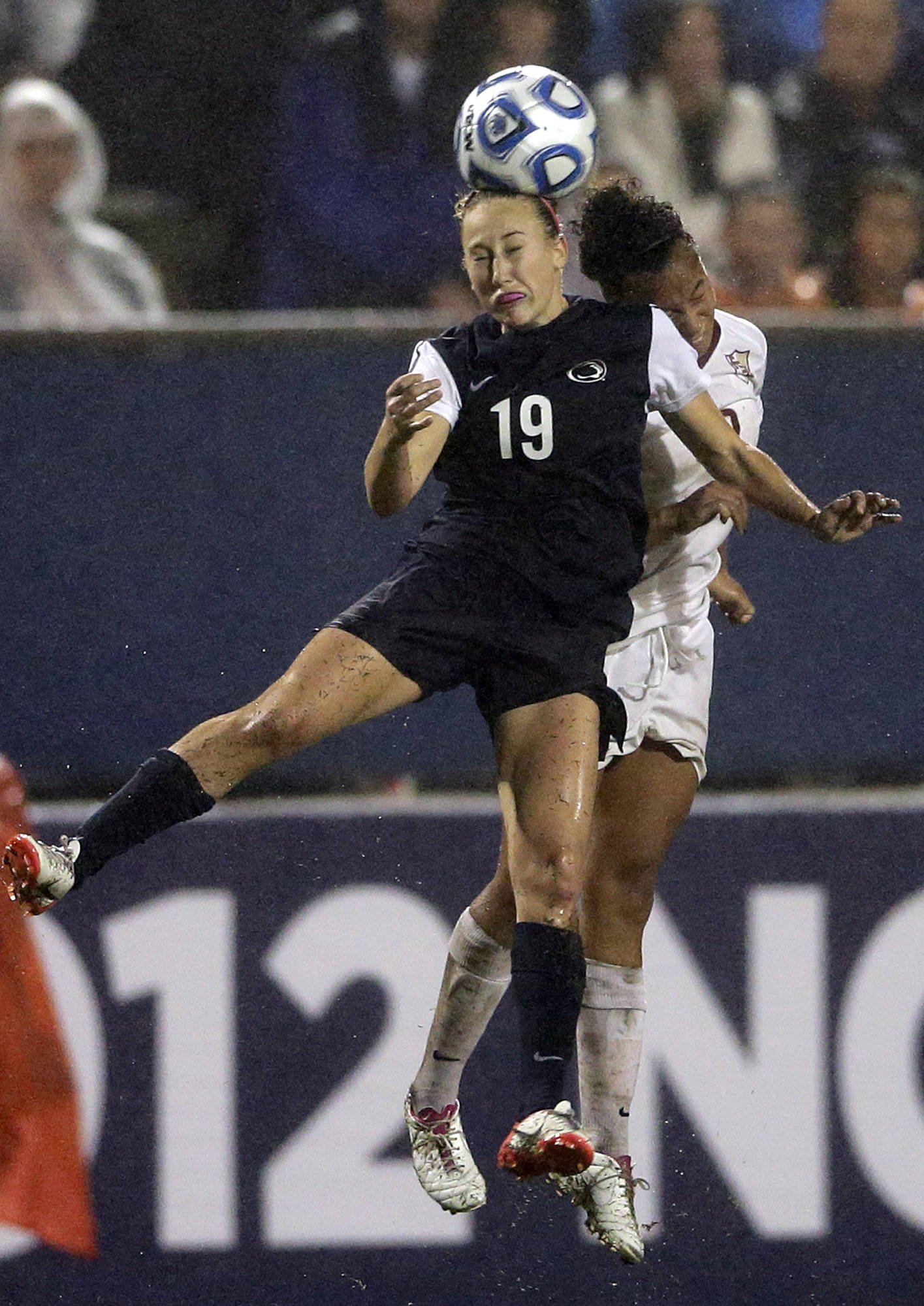 Penn State's Taylor Schram, left, and Ines Jaurena vie for a header. (AP Photo/Gregory Bull)