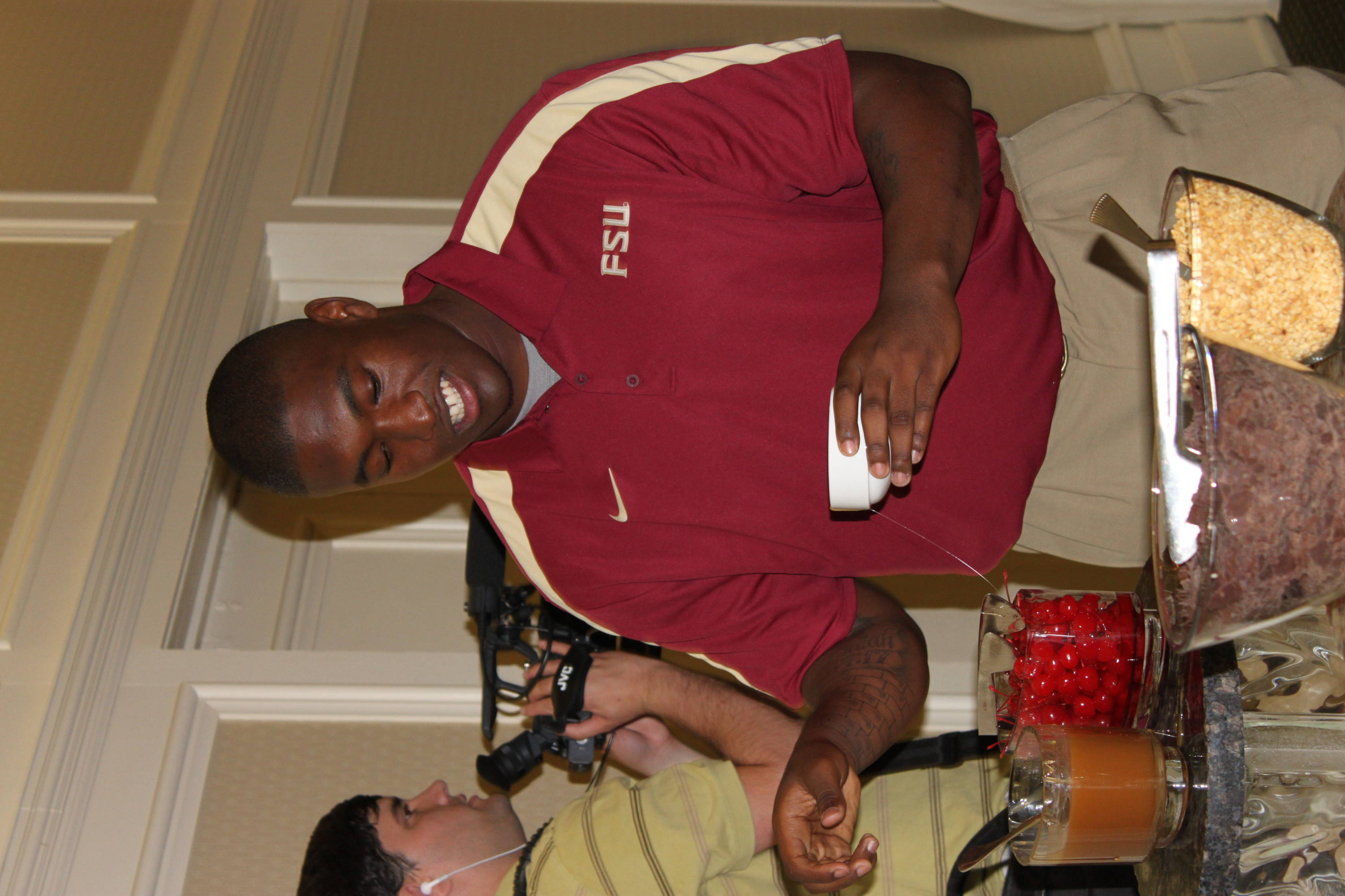 After the first round of interviews, Brandon Jenkins took a little break at the ice cream social station ...