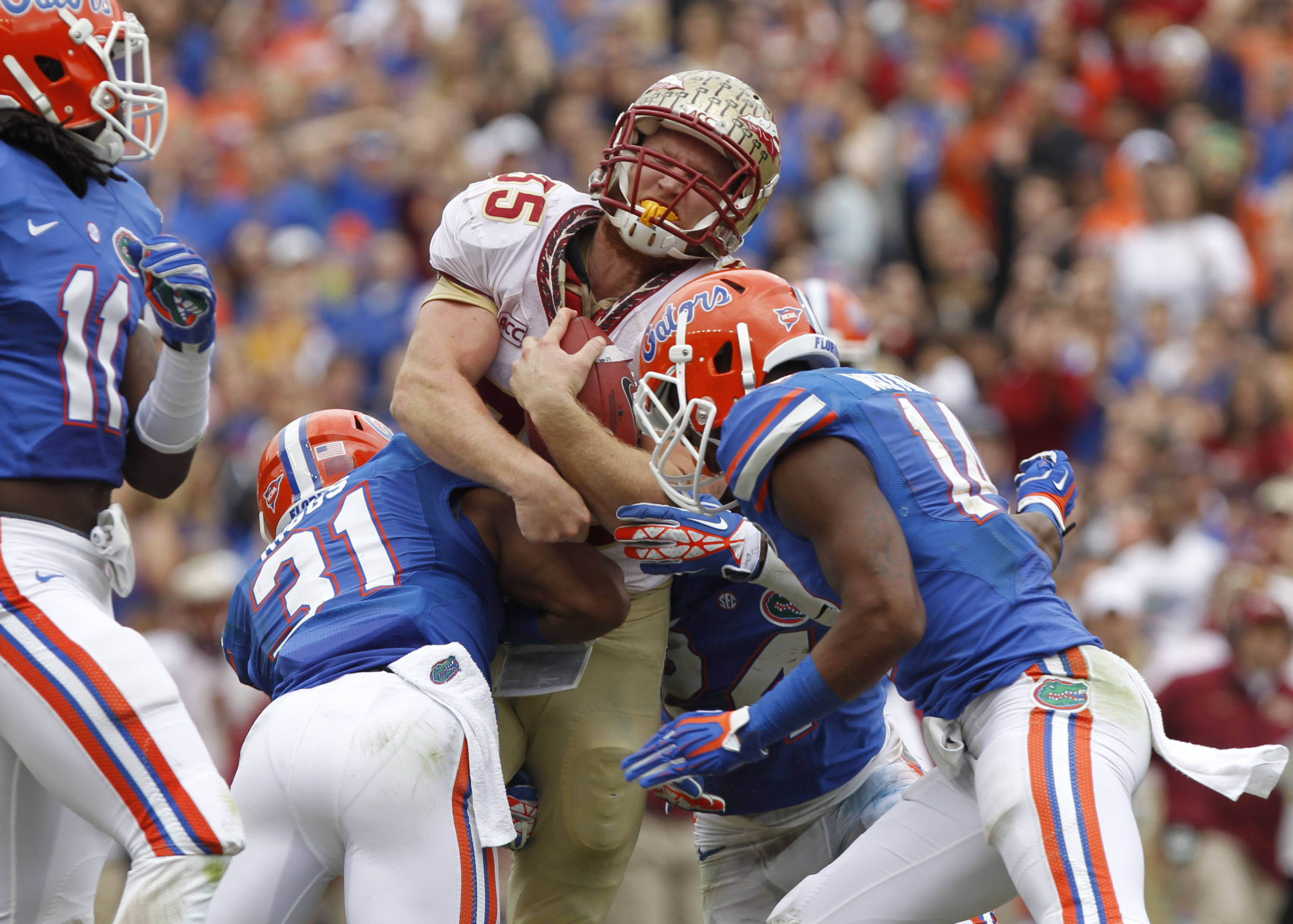 Nick O'Leary (35) runs with the ball as Florida Gators defensive back Cody Riggs (31) defends. Mandatory Credit: Kim Klement-USA TODAY Sports