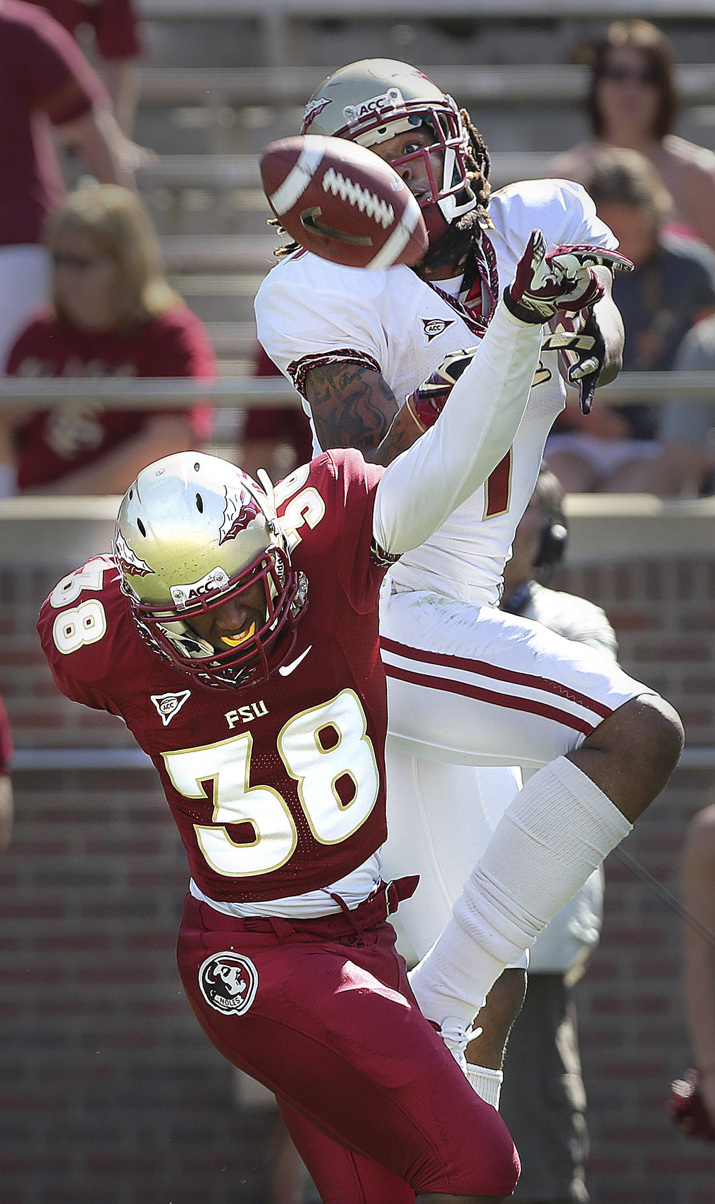 Florida State's Kelvin Benjamin eyes a reception but defensive back Justin Allred broke up the play on Saturday during the Spring Football game inside of Doak Campbell Stadium on April 13, 2013. An estimated 25, 000 people came out to get a first look at the Seminoles.  (AP Photo/Tallahassee Democrat, Mike Ewen)