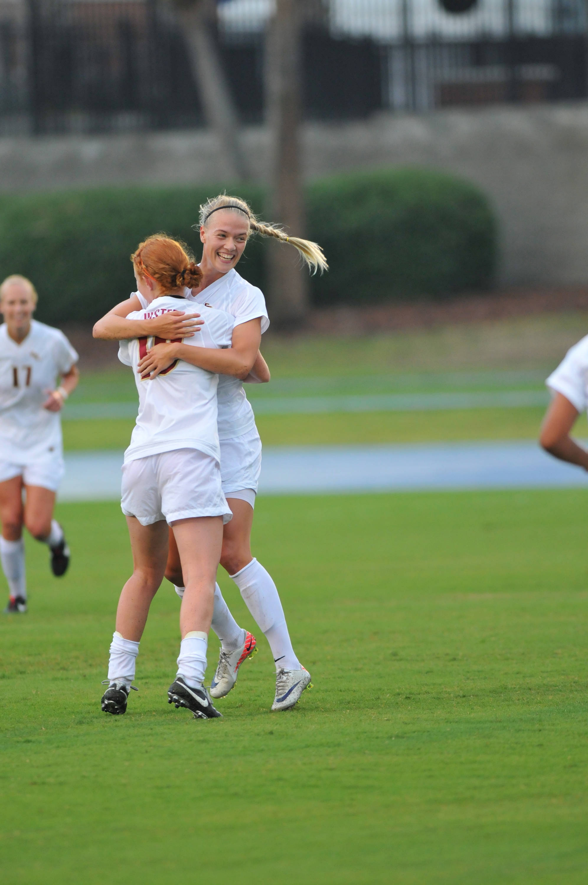 Dagny Brynjarsdottir celebrates with Tori Huster after scoring the first goal of the game against Florida.