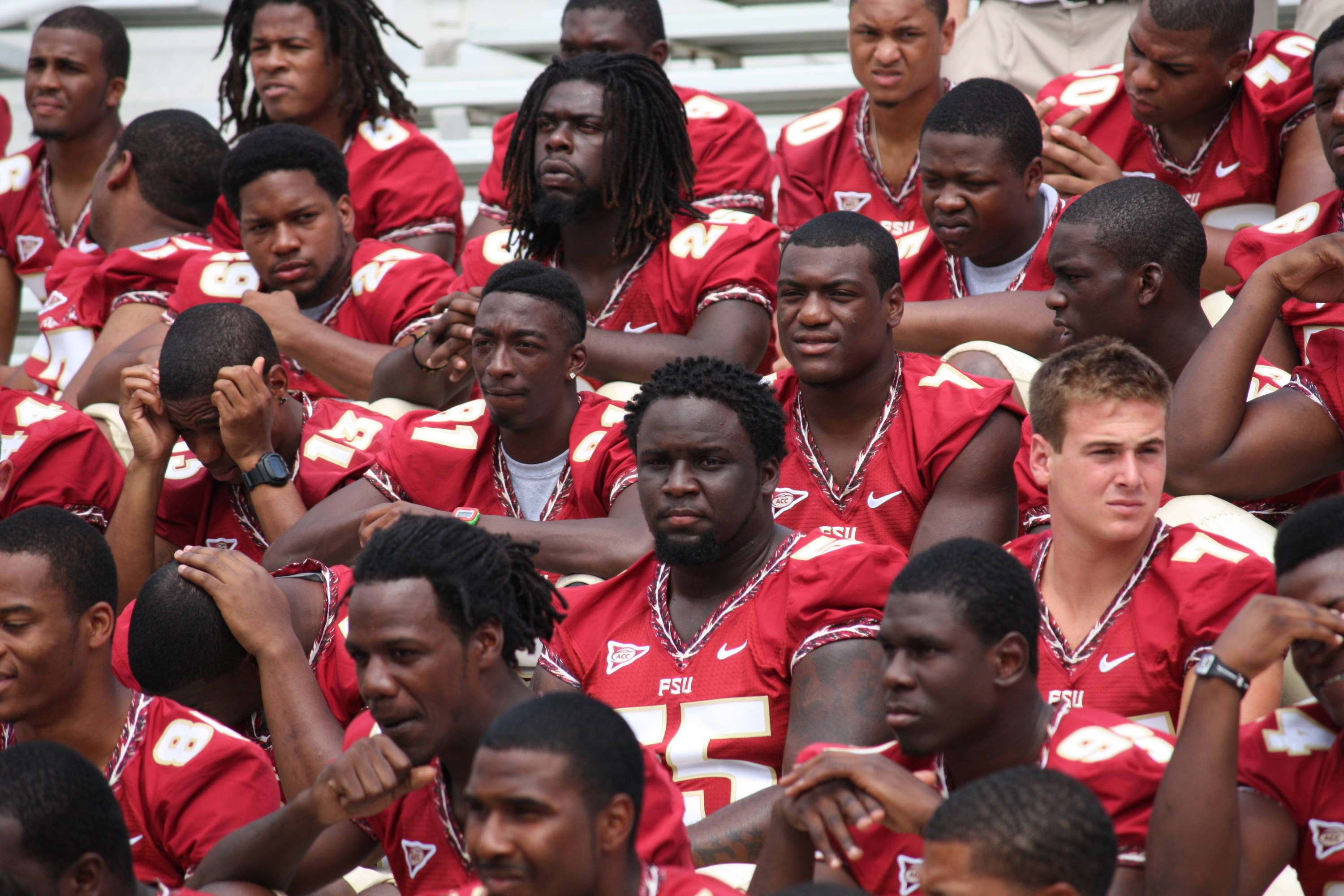 Kenny Shaw, Chrisitan Jones, Arrington Jenkins, Eric Beverly, Jacobbi McDaniel and the rest of the team get ready for the team photo.