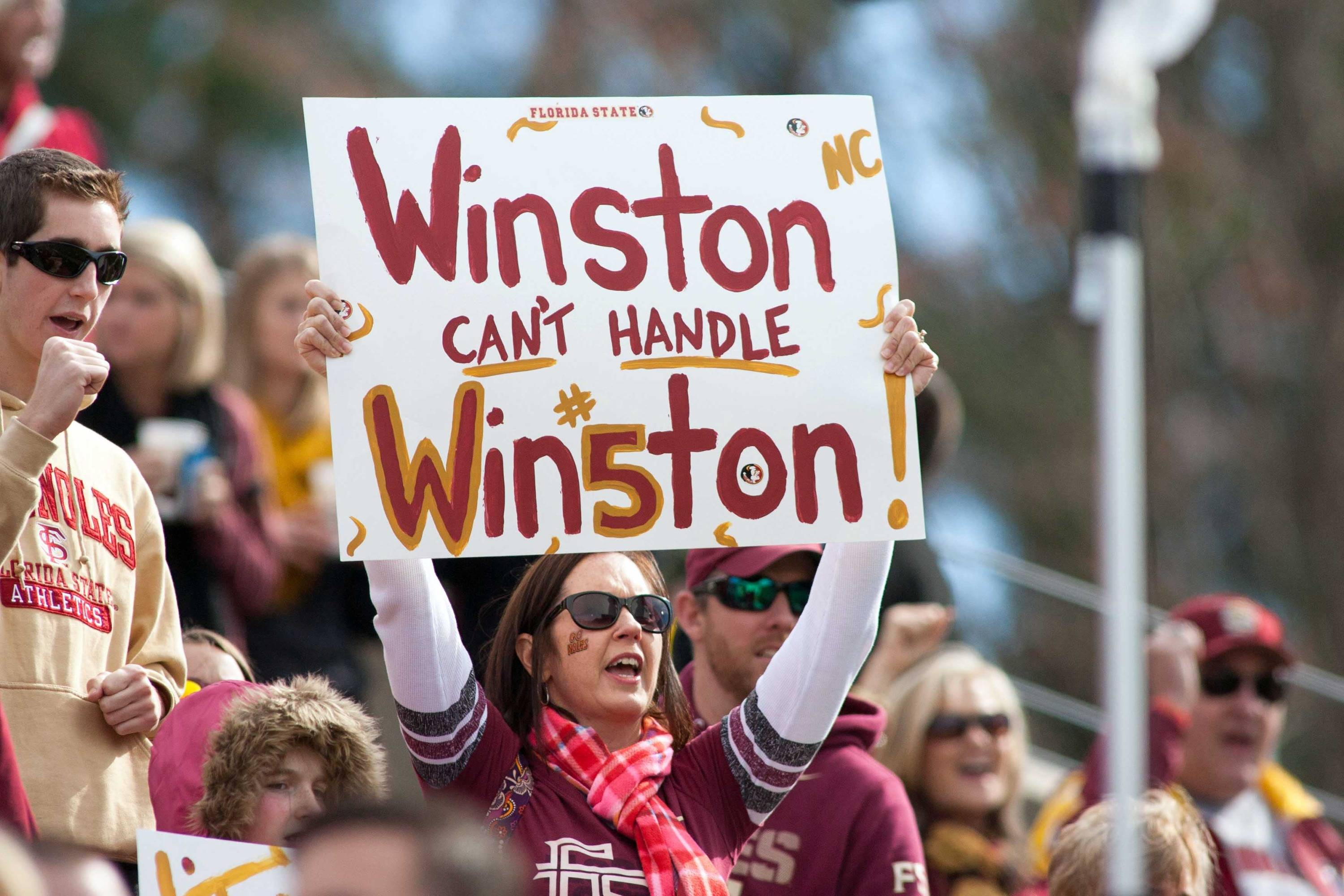 A Florida State Seminoles fan holds up a sign during the first half. Mandatory Credit: Jeremy Brevard-USA TODAY Sports
