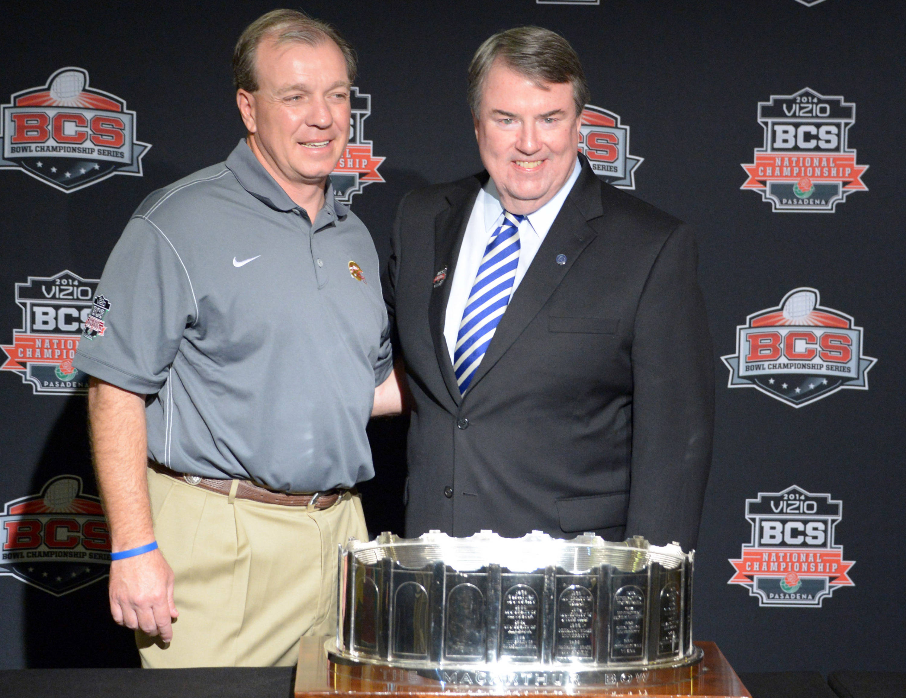 Florida State Seminoles coach Jimbo Fisher (left) is presented by MacArthur Bowl trophy by National Football Foundation president Steve Hatchell at 2014 BCS National Championship press conference at Newport Beach Marriott. Mandatory Credit: Kirby Lee-USA TODAY Sports