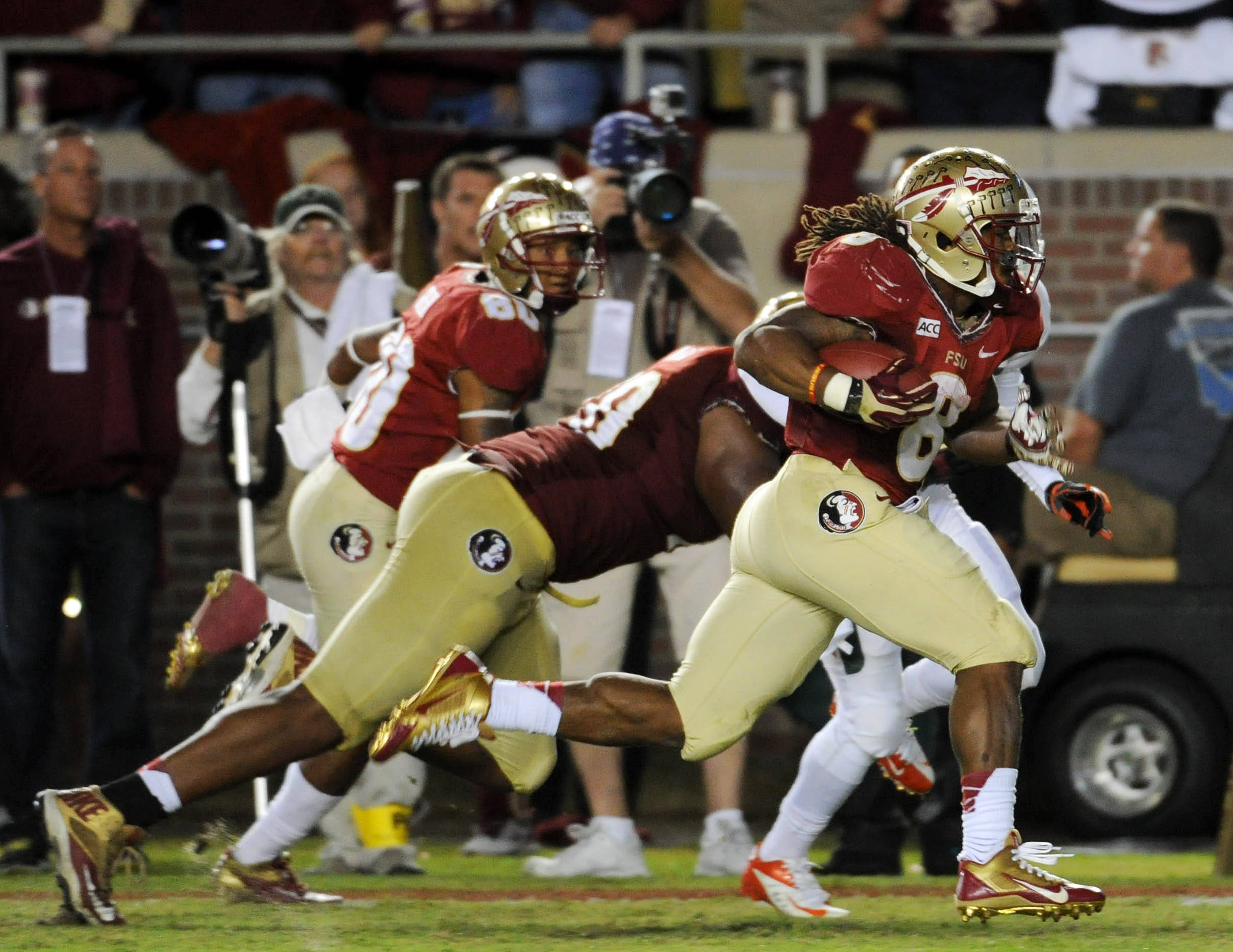 Florida State Seminoles running back Devonta Freeman (8) runs the ball for a touchdown against the Miami Hurricanes during the first half at Doak Campbell Stadium. Mandatory Credit: Melina Vastola-USA TODAY Sports