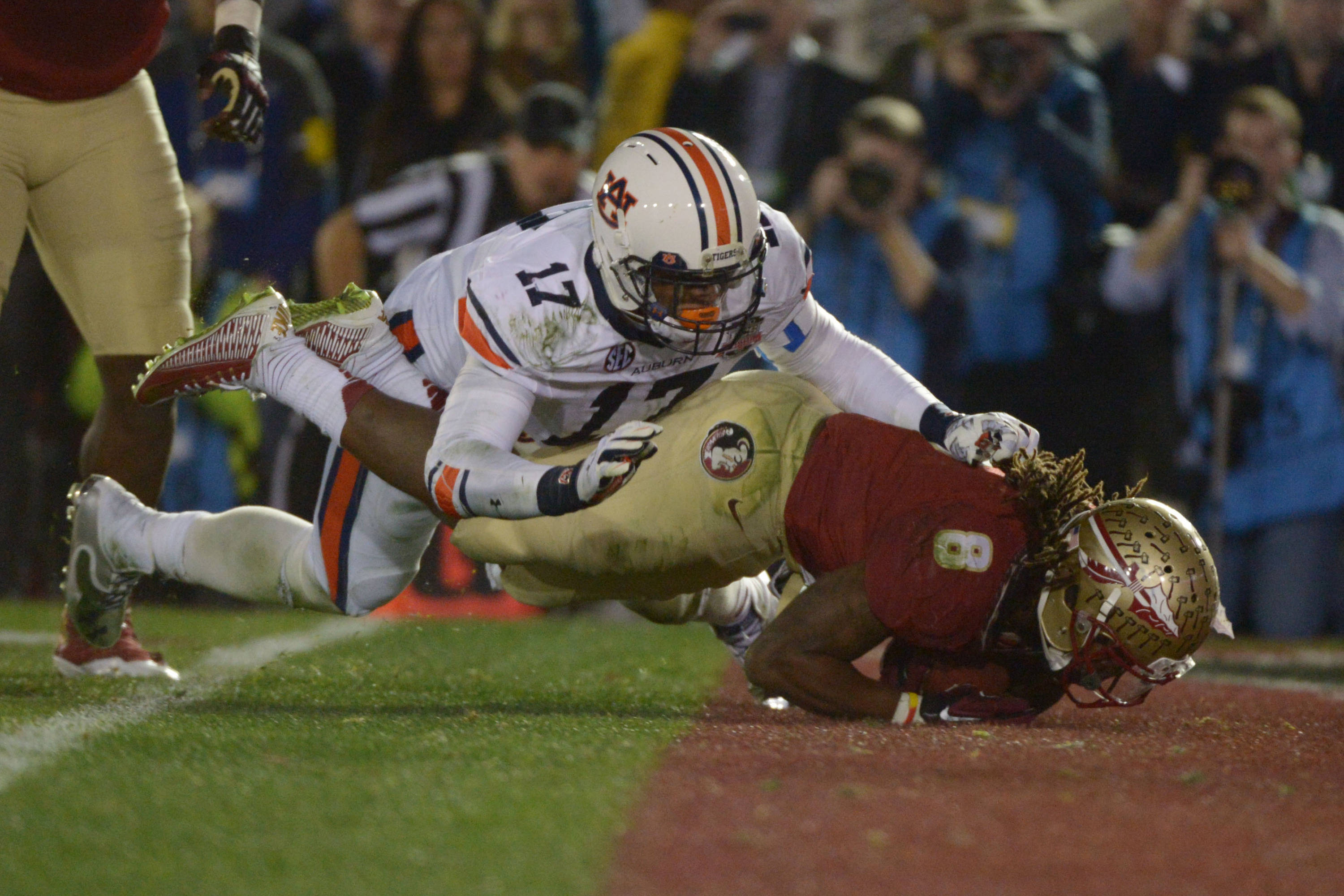 Jan 6, 2014; Pasadena, CA, USA; Florida State Seminoles running back Devonta Freeman (8) scores a touchdown against Auburn Tigers linebacker Kris Frost (17) during the first half of the 2014 BCS National Championship game at the Rose Bowl.  Mandatory Credit: Kirby Lee-USA TODAY Sports