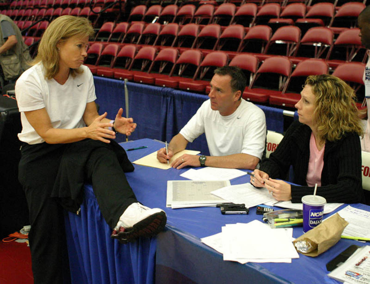 Coach Sue talks with ESPN talent Jimmy Dykes and Beth Mowins following Sunday's practice.