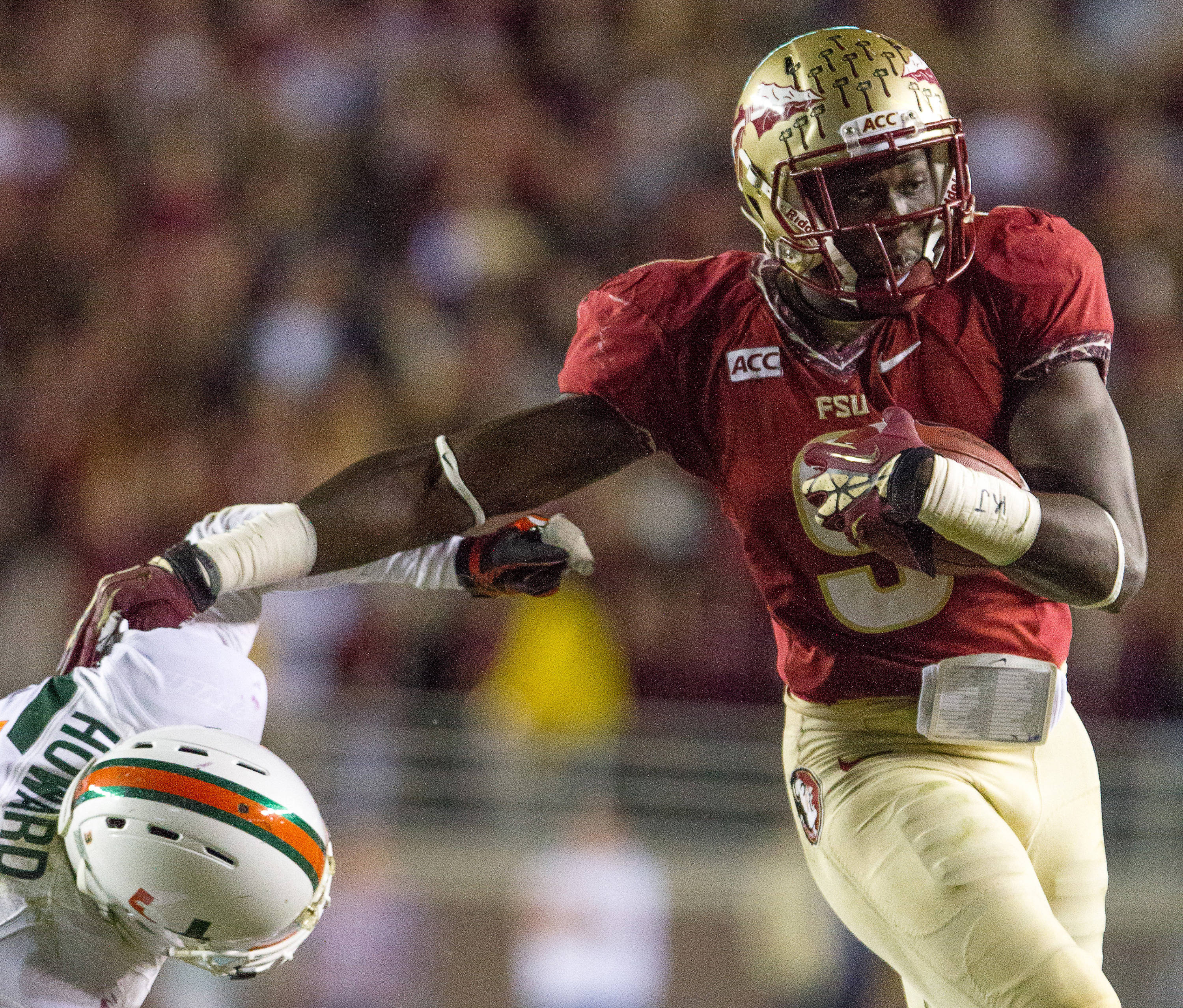 Karlos Williams (9) carries the ball during FSU football's 41-14 win over Miami on Saturday, November 2, 2013 in Tallahassee, Fla. Photo by Michael Schwarz.