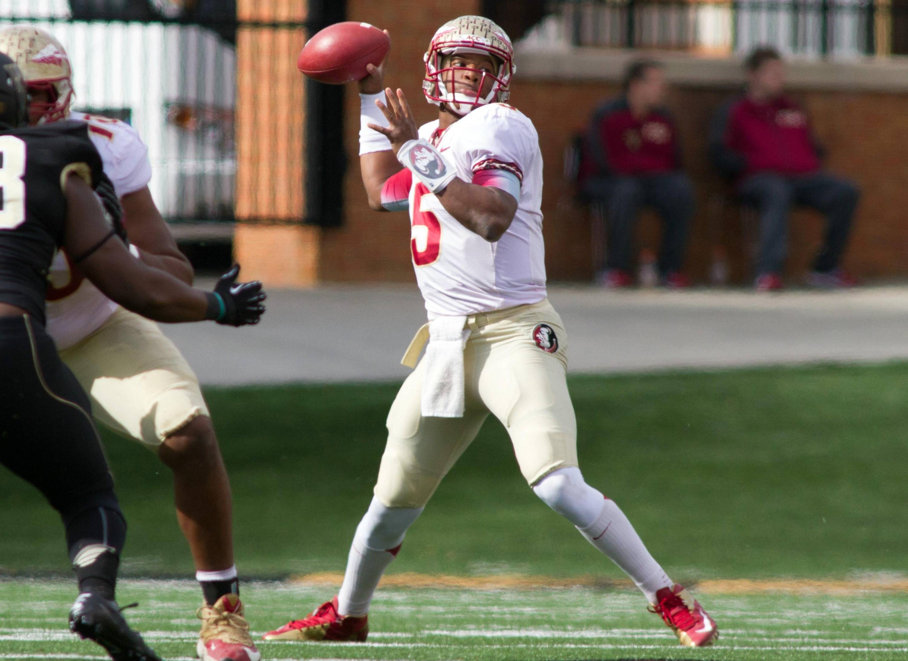 Jameis Winston (5) passes the ball during the second quarter. Mandatory Credit: Jeremy Brevard-USA TODAY Sports