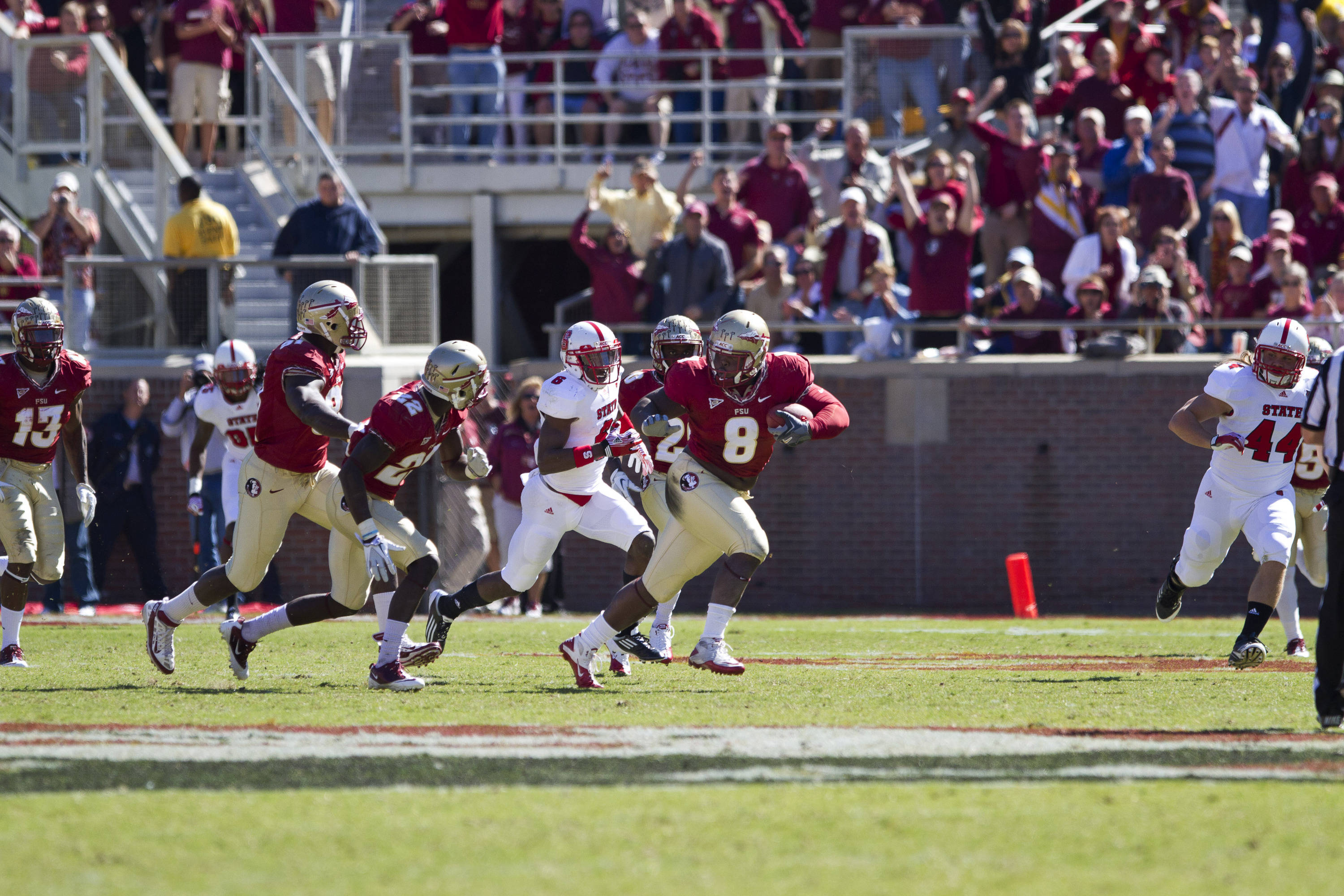 Timmy Jernigan (8) runs the ball after an interception during the football game against NC State on October 29, 2011.