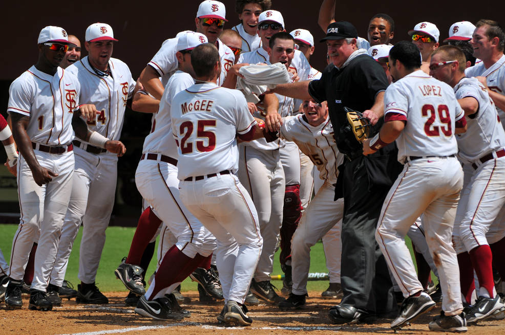 The Noles celebrate at home plate following Mike McGee's walk-off home run in the bottom of the ninth.