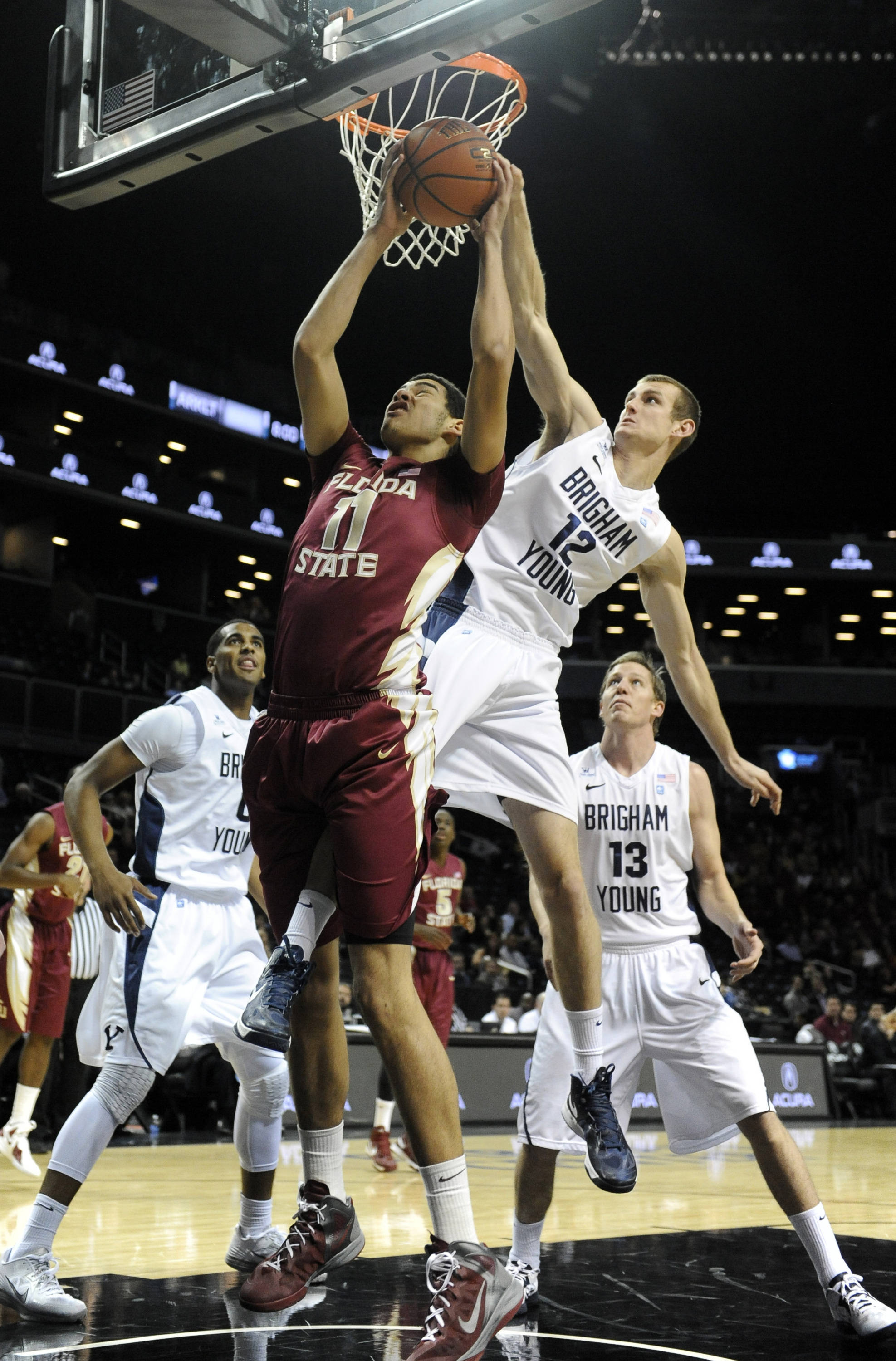 Florida State's Kiel Turpin (11) and Brigham Young's Josh Sharp (12) battle for a rebound in the first half. (AP Photo/Kathy Kmonicek)