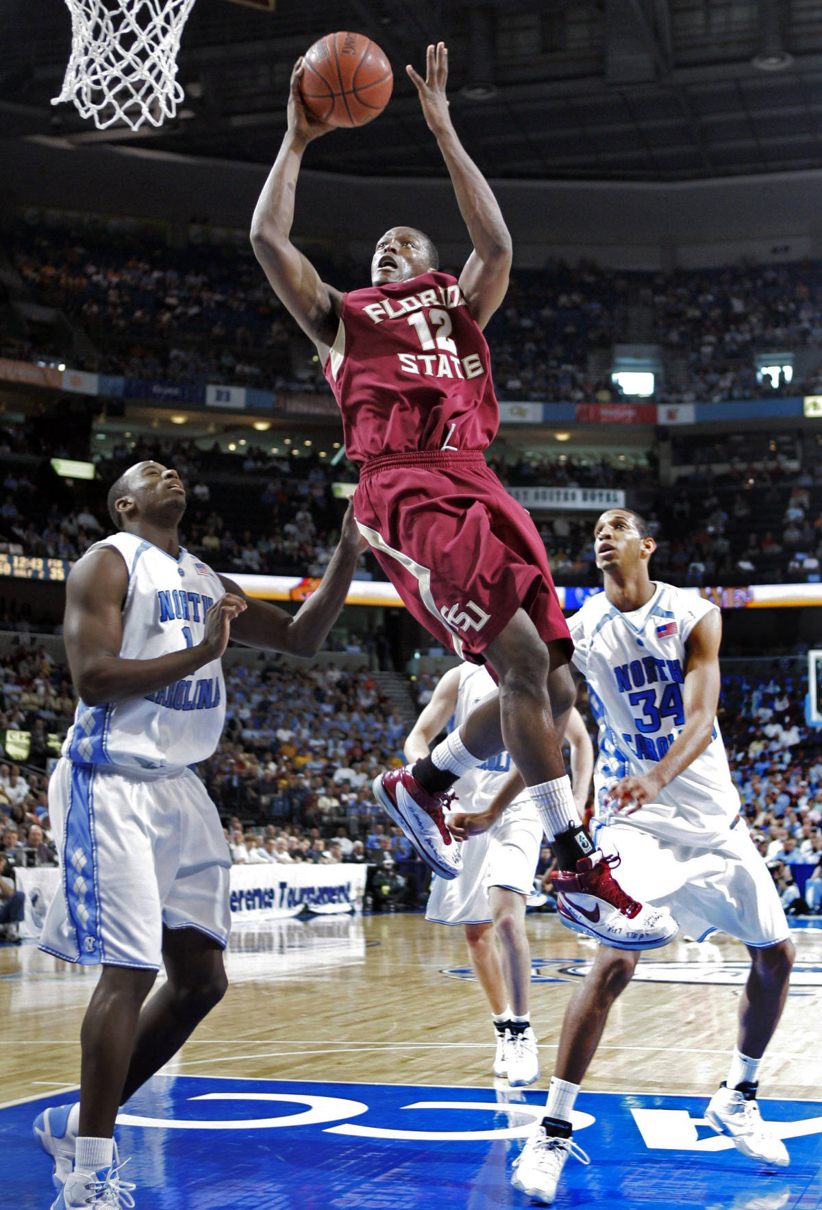 Florida State's Al Thornton (12) leaps for a shot between North Carolina's Marcus Ginyard (1) and Brandan Wright (34) during a second round game of the Men's Atlantic Coast Conference basketball tournament in Tampa, Fla., Friday, March 9, 2007. (AP Photo/David J. Phillip)