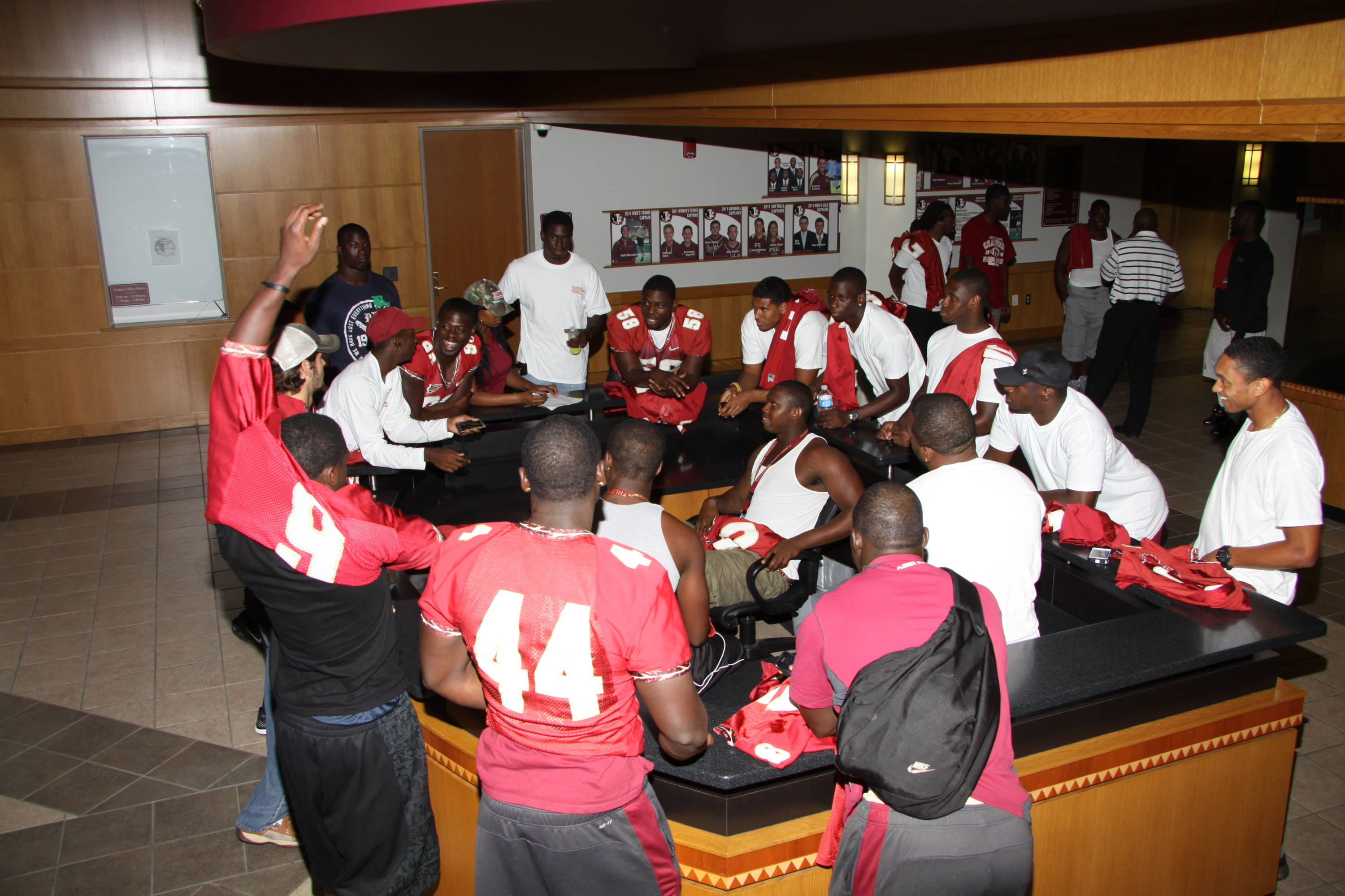 Players meet at the Moore Center before heading out for community service projects.