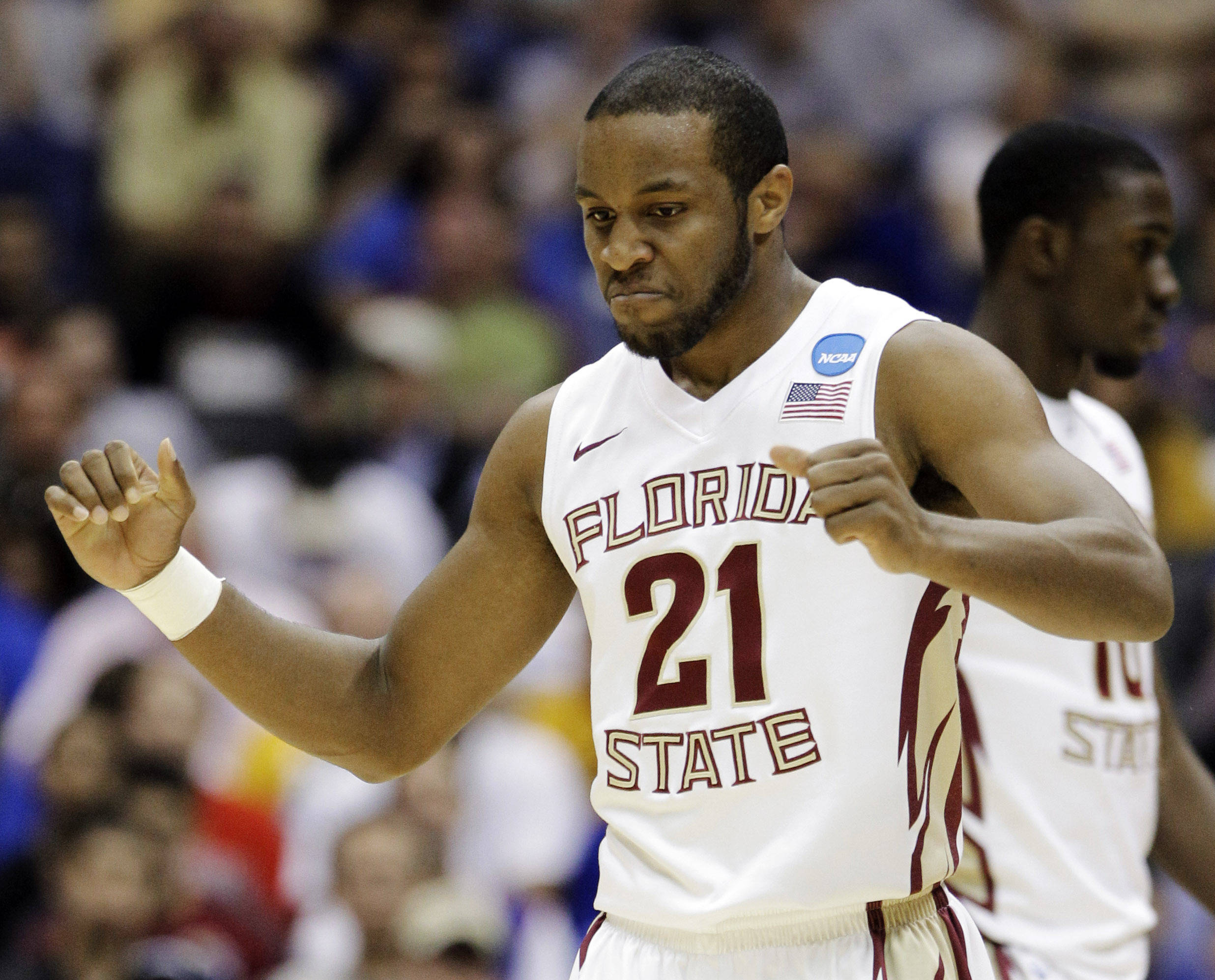Florida State's Michael Snaer reacts to action against the Virginia Commonwealth during the first half of a Southwest regional semifinal game. (AP Photo/Tony Gutierrez)