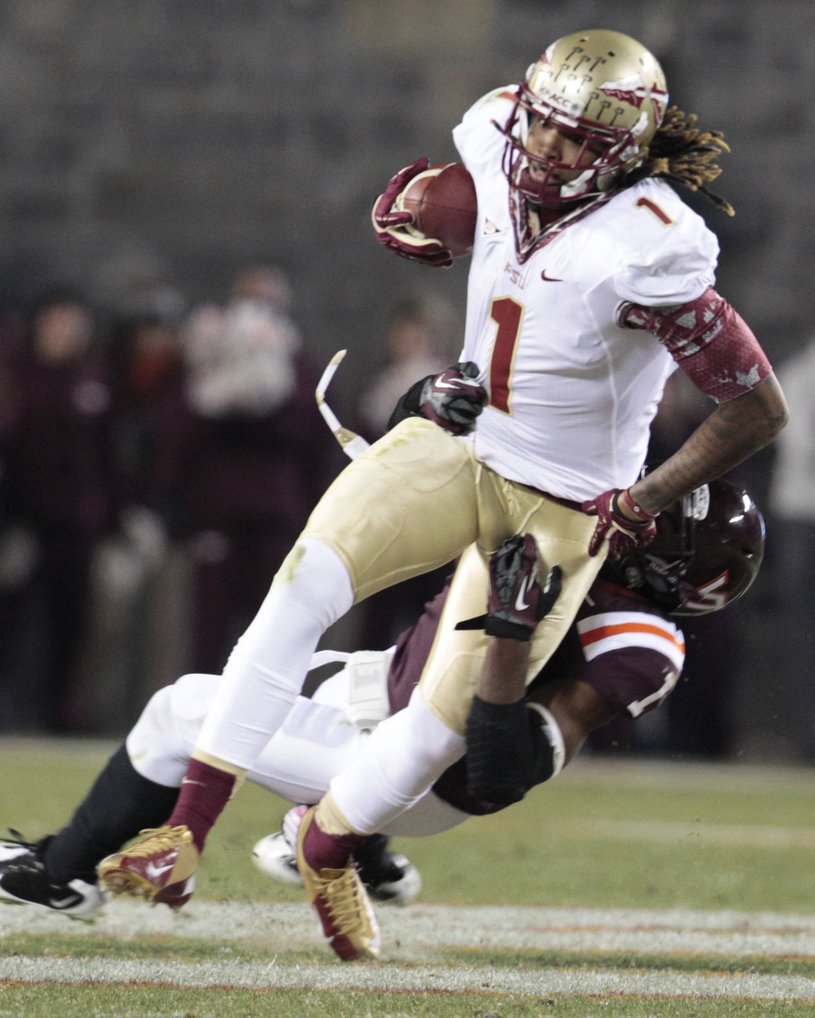 Florida State wide receiver Kelvin Benjamin (1) is brought down by Virginia Tech cornerback Antone Exum (1). (AP Photo/Steve Helber)