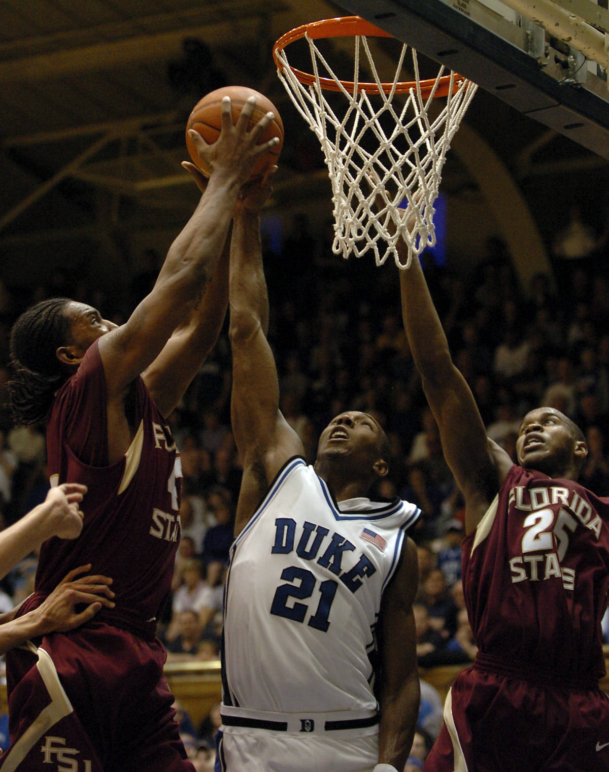 Florida State's Ryan Reid, left, controls a rebound over Jason Rich (25) Duke's DeMarcus Nelson (21) in the second half of a basketball game in Durham, N.C., on Sunday, Feb. 4, 2007. Florida State upset Duke 68-67. (AP Photo/Sara D. Davis)