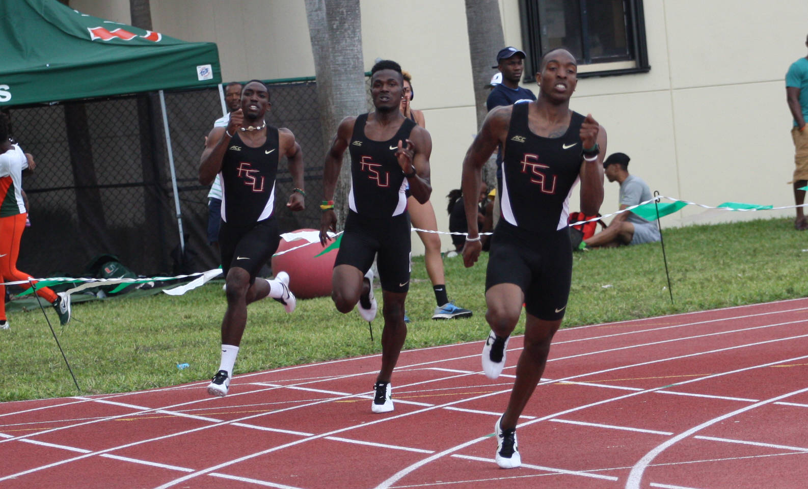 R-to-L, Michael Cherry, Alistair Moona and Ricky Roy off the turn in the 400.