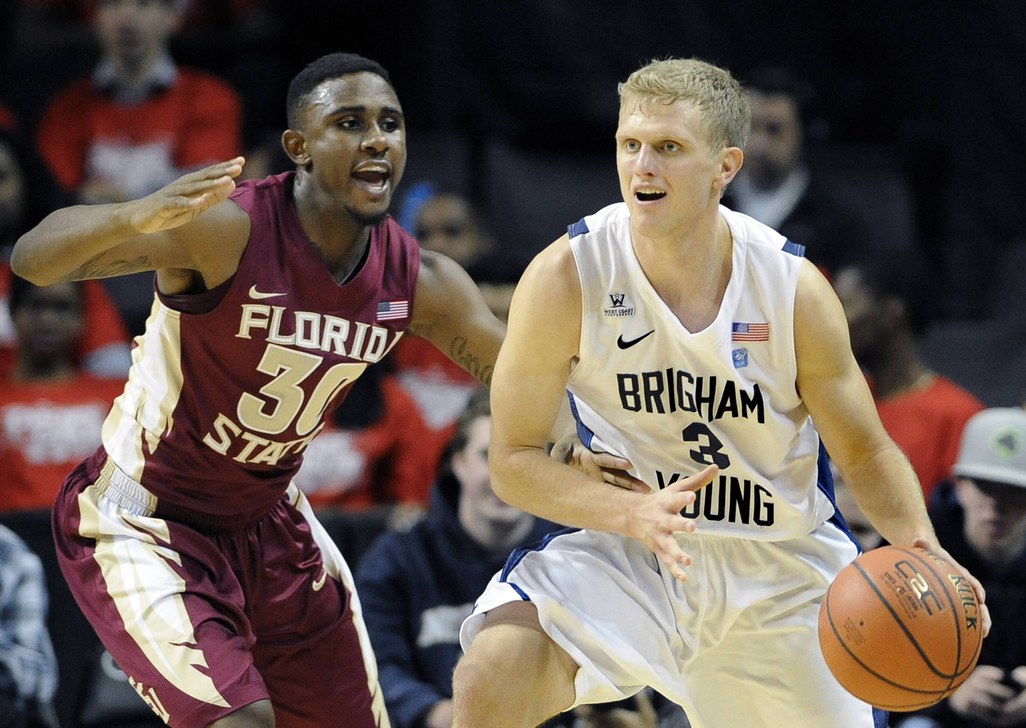 Florida State's Ian Miller (30) guards Brigham Young's Tyler Haws (3) in the first half. (AP Photo/Kathy Kmonicek)