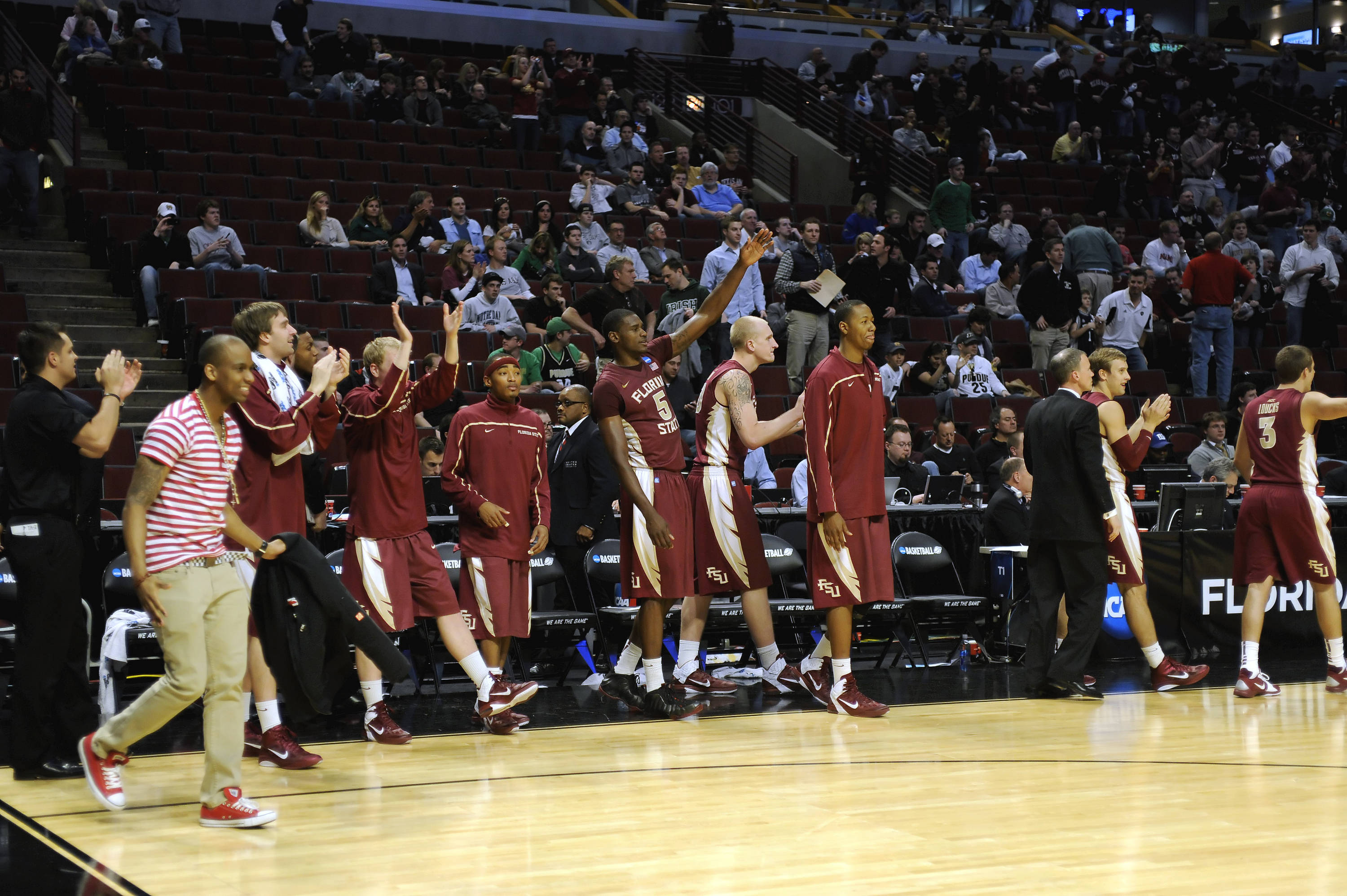 The Florida State bench celebrates the team's second round NCAA Tournament victory