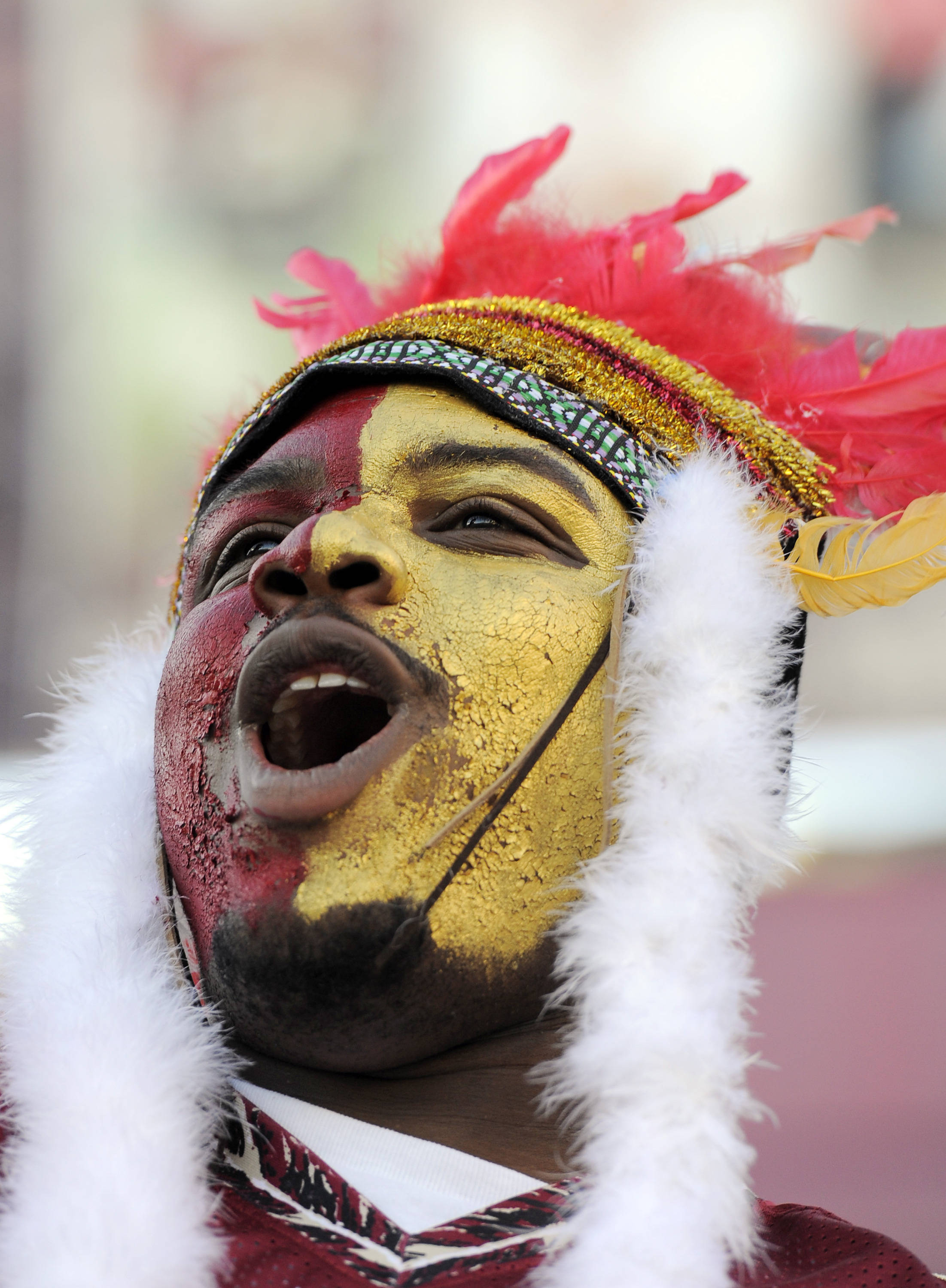 Florida State Seminoles fan Javar Bait cheers from the stands as student pour into the stadium before the game against the Miami Hurricanes at Doak Campbell Stadium. Mandatory Credit: John David Mercer-USA TODAY Sports