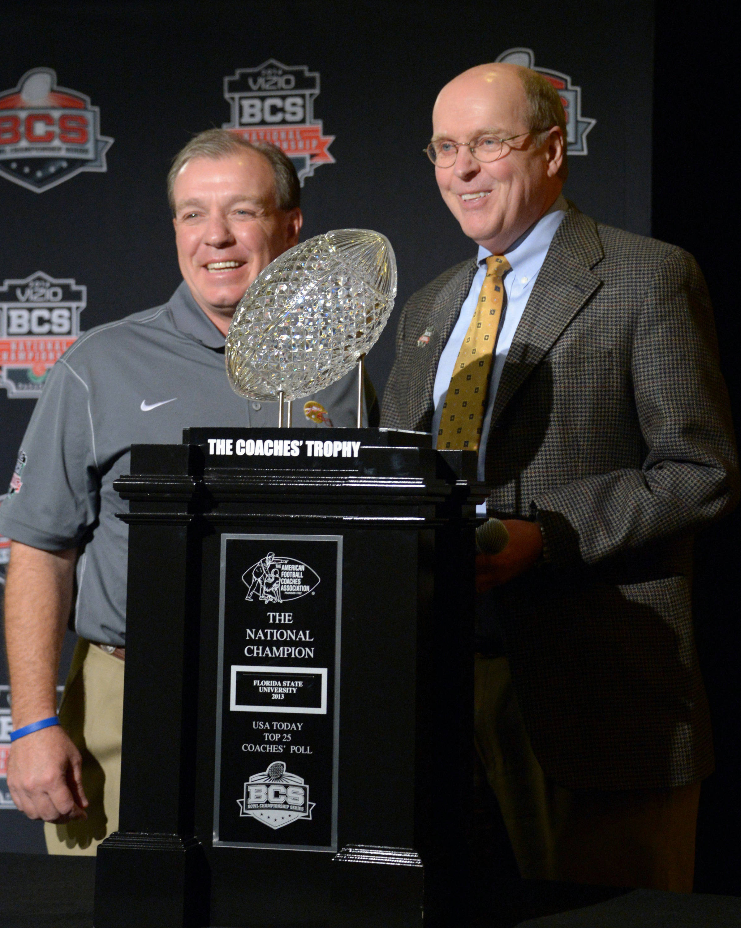 Florida State Seminoles coach Jimbo Fisher (left) poses with BCS executive director Bill Hancock and the Coaches Trophy at 2014 BCS National Championship press conference at Newport Beach Marriott. Mandatory Credit: Kirby Lee-USA TODAY Sports