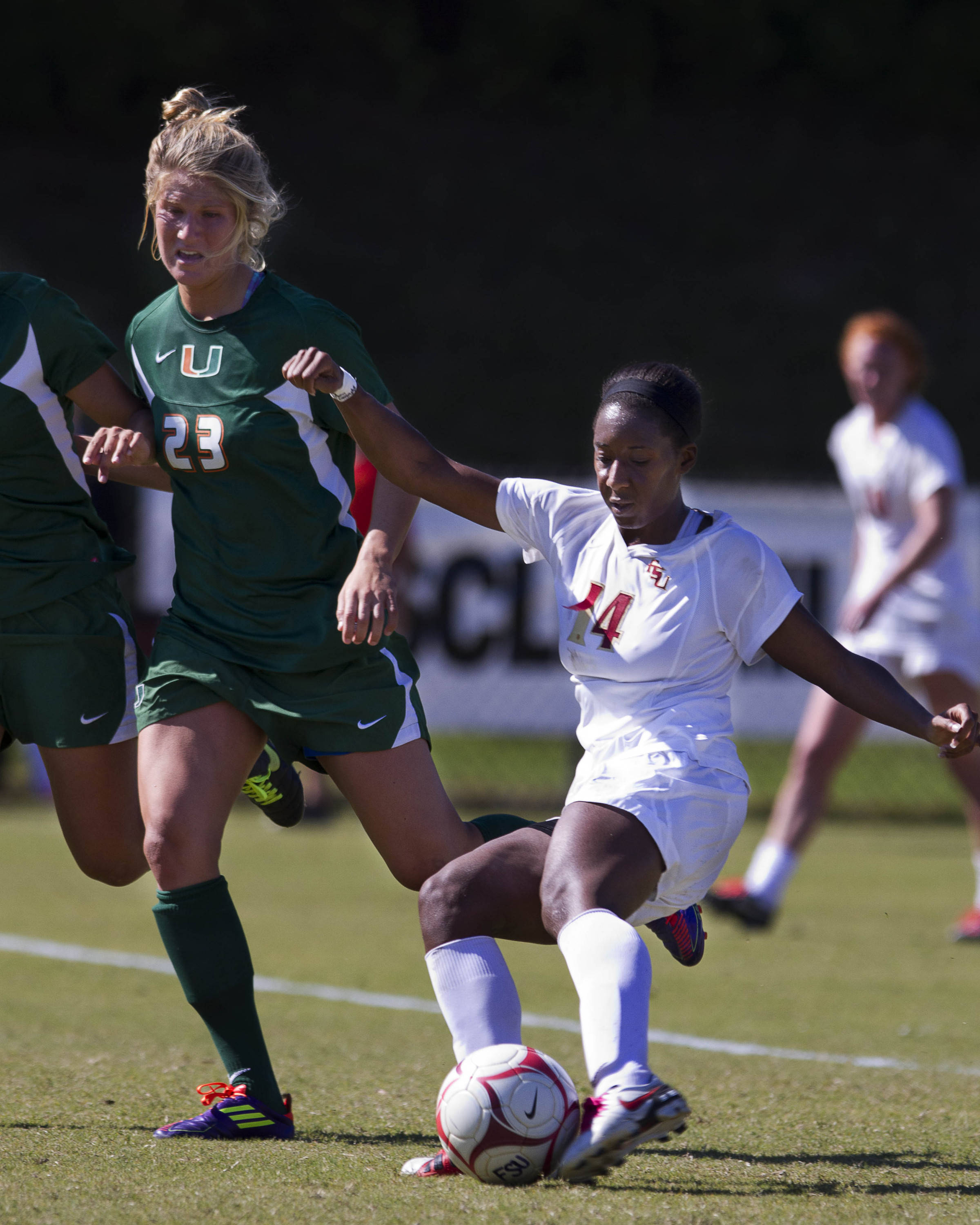 Tiffany McCarty (14) takes a left footed shot to score a goal for the Seminoles.