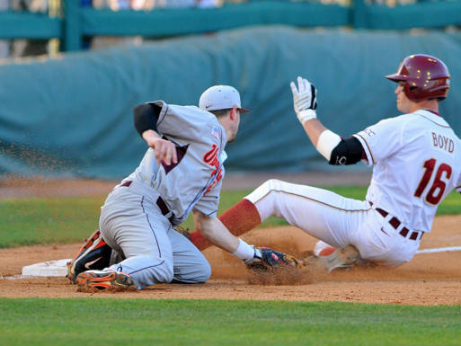 Jayce Boyd slides in safely at third base.
