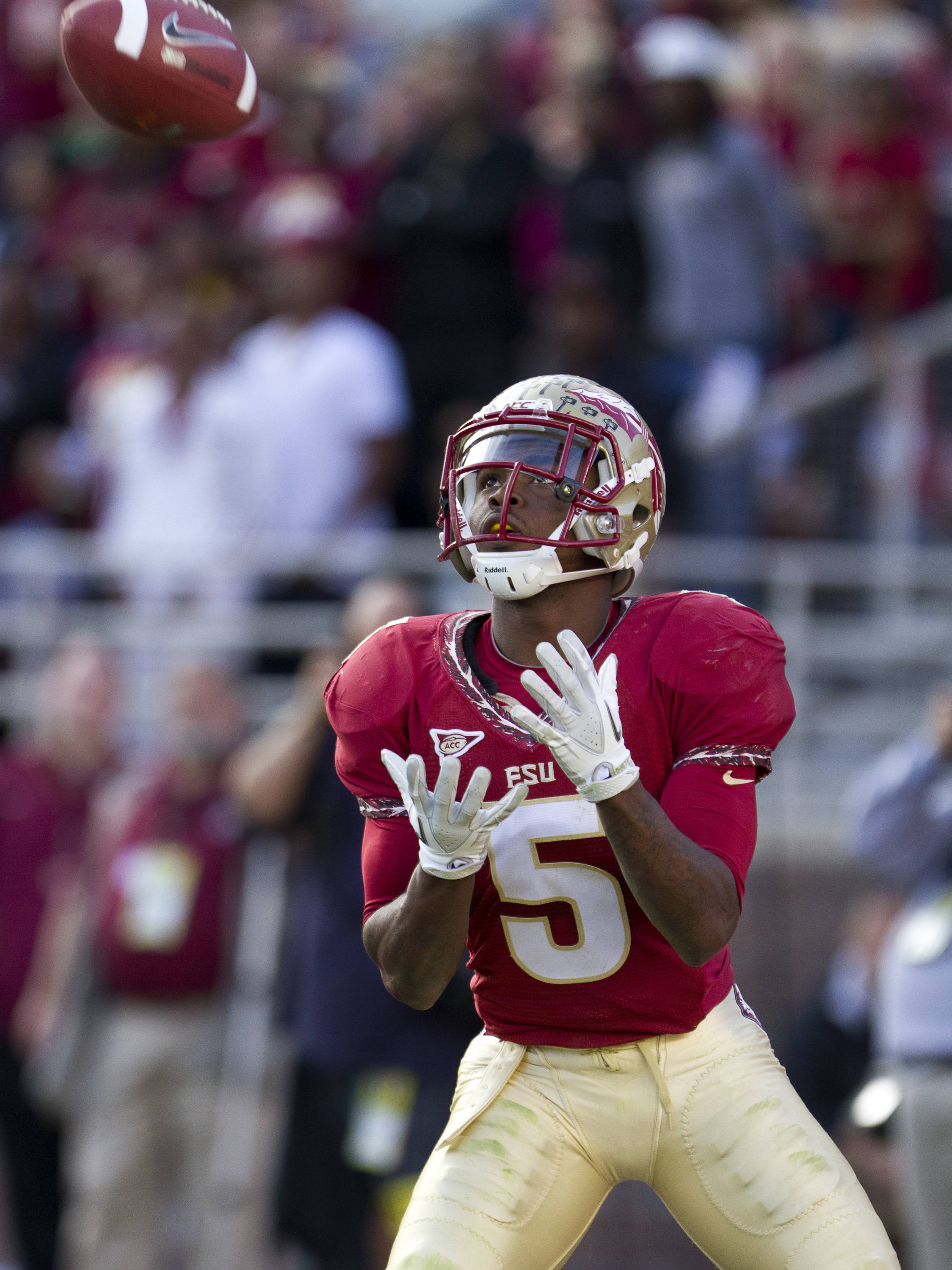 Greg Reid (5) returns a kickoff during the football game against Miami on November 12, 2011.