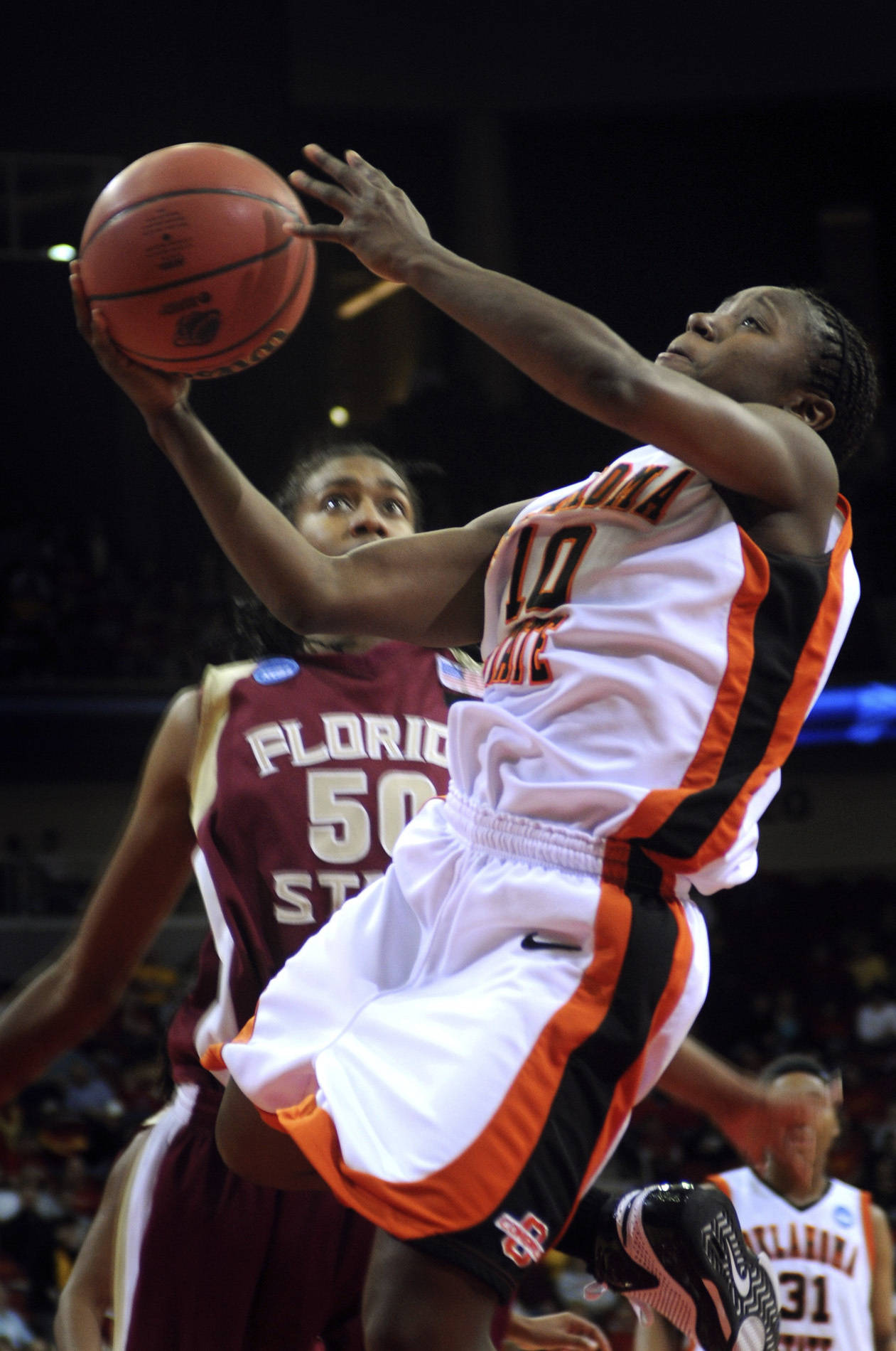 Oklahoma State's Andrea Riley, right, shoots as Florida State's Jacinta Monroe defends during the second half of an NCAA women's basketball tournament second round game, Monday, March 24, 2008 in Des Moines, Iowa. Riley made a free throw with 0.7 seconds left on the clock in overtime to give Oklahoma State a 73-72 win over Florida State. (AP Photo/Steve Pope)
