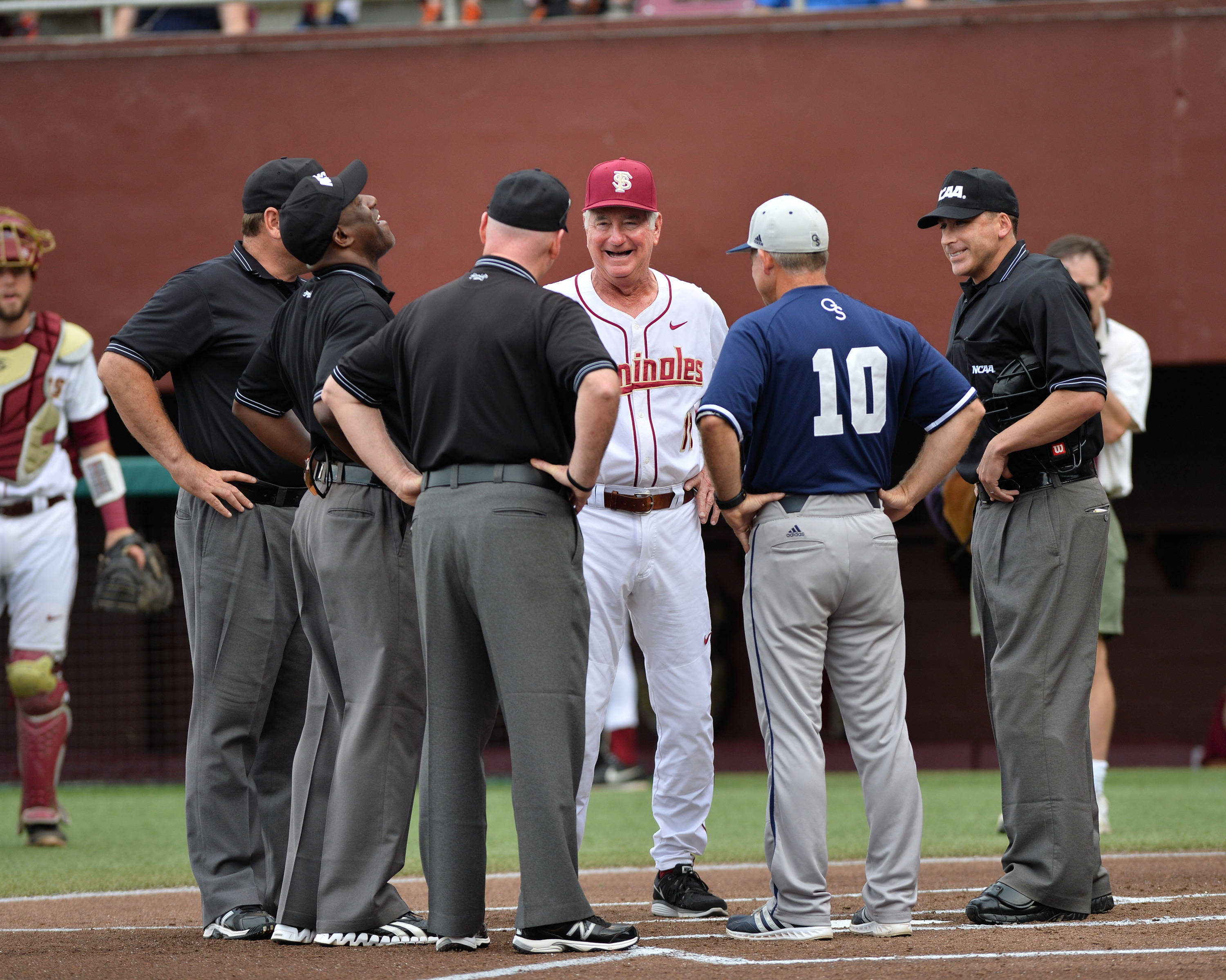 FSU head coach Mike Martin and GSU head coach Rodney Hennon talk to the umpires prior to Friday's first pitch.