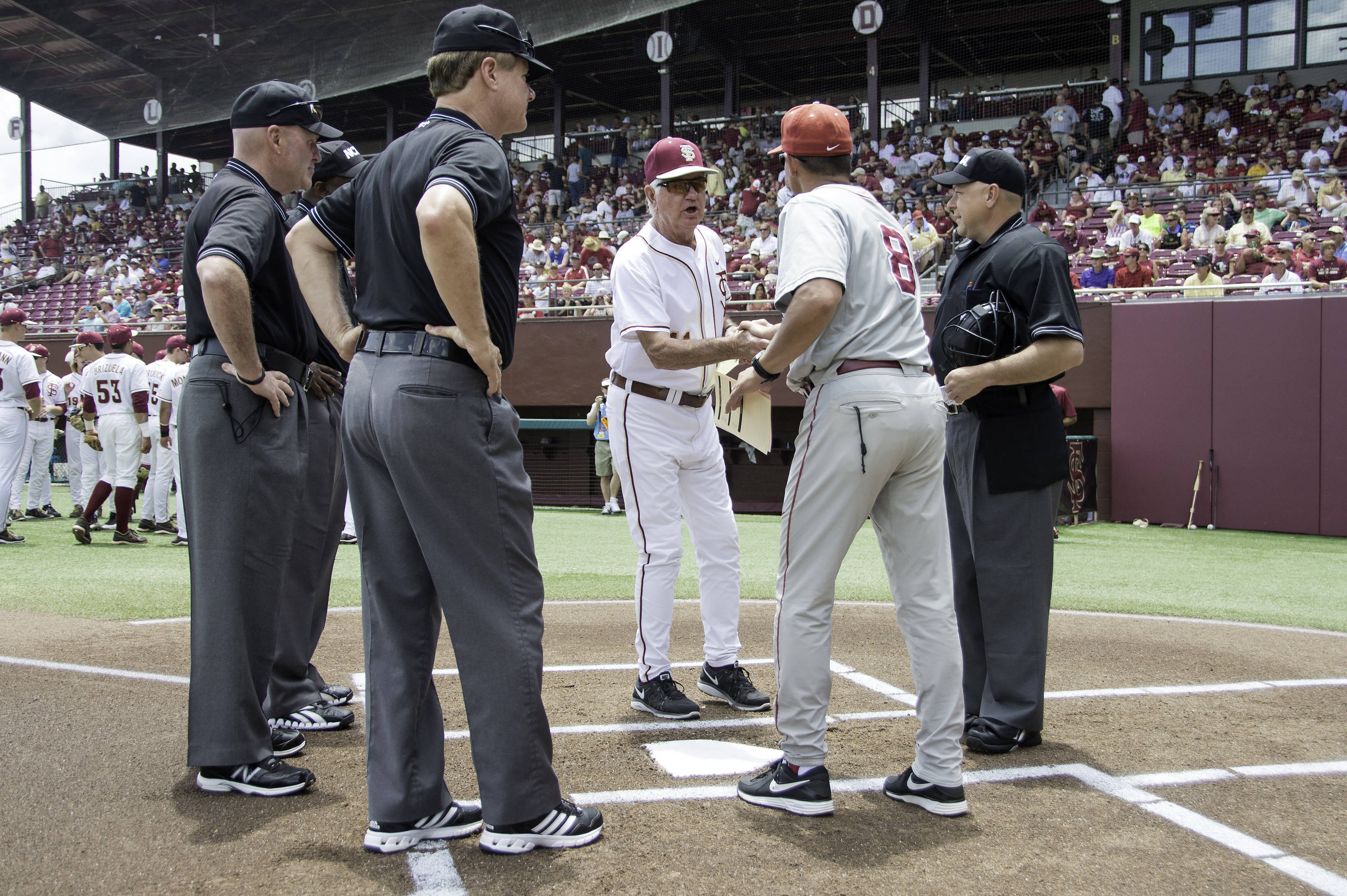 Florida State's Mike Martin meets with Alabama head coach Mitch Gaspard.
