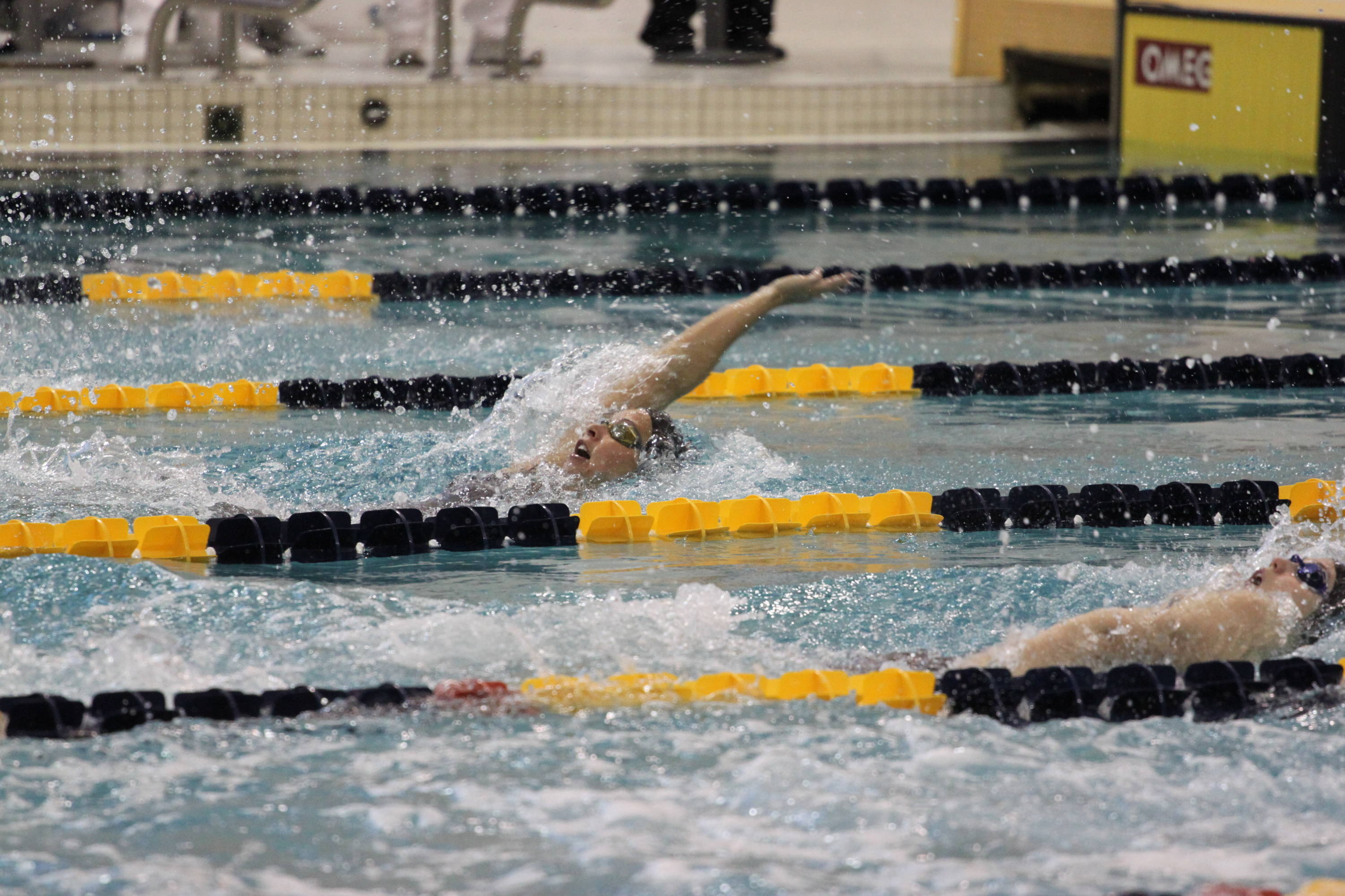Brittany Selts leading off the 200 medley relay