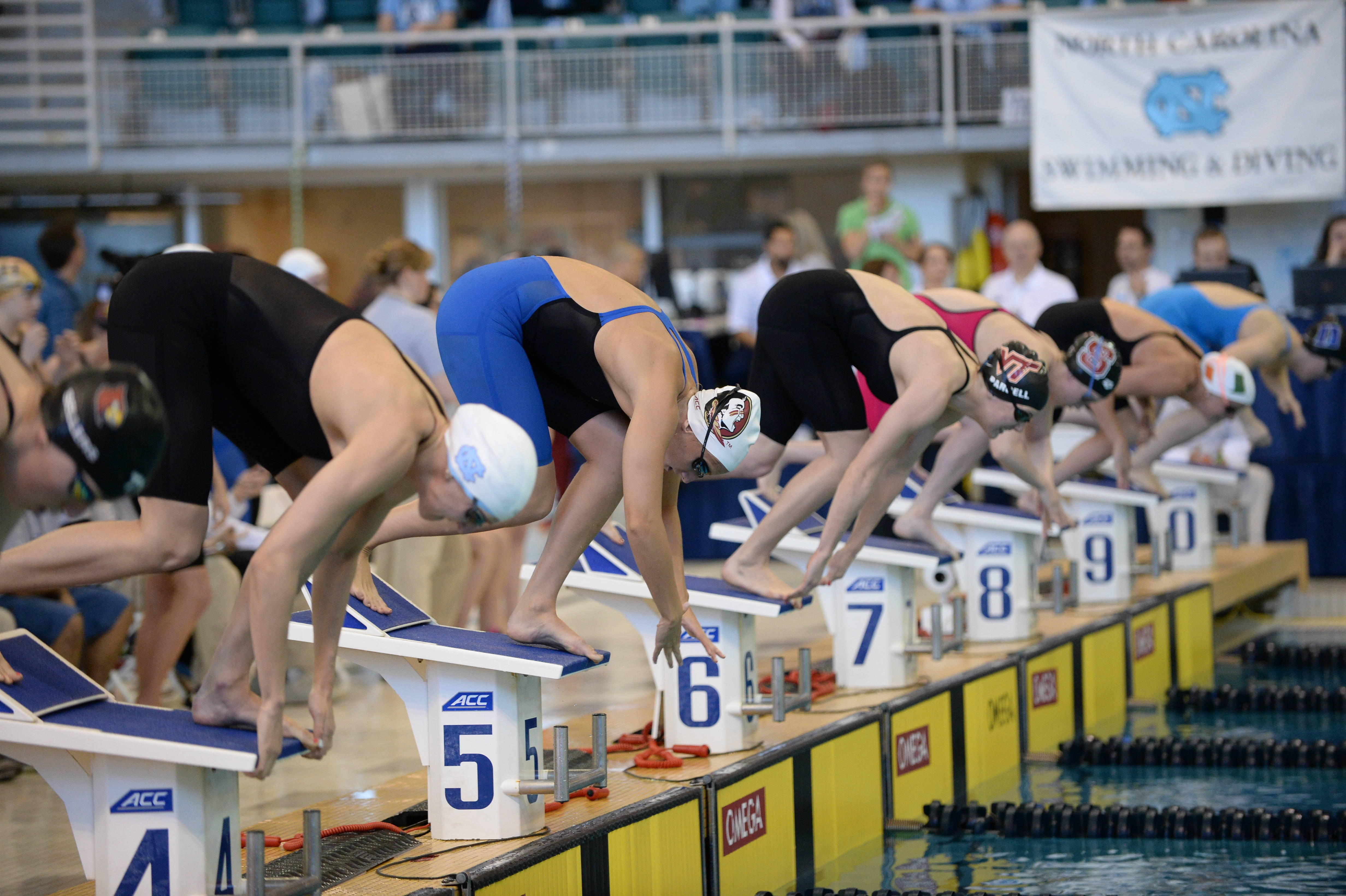 Sami Pochowski gets off the block in the 100 breast - Mitch White