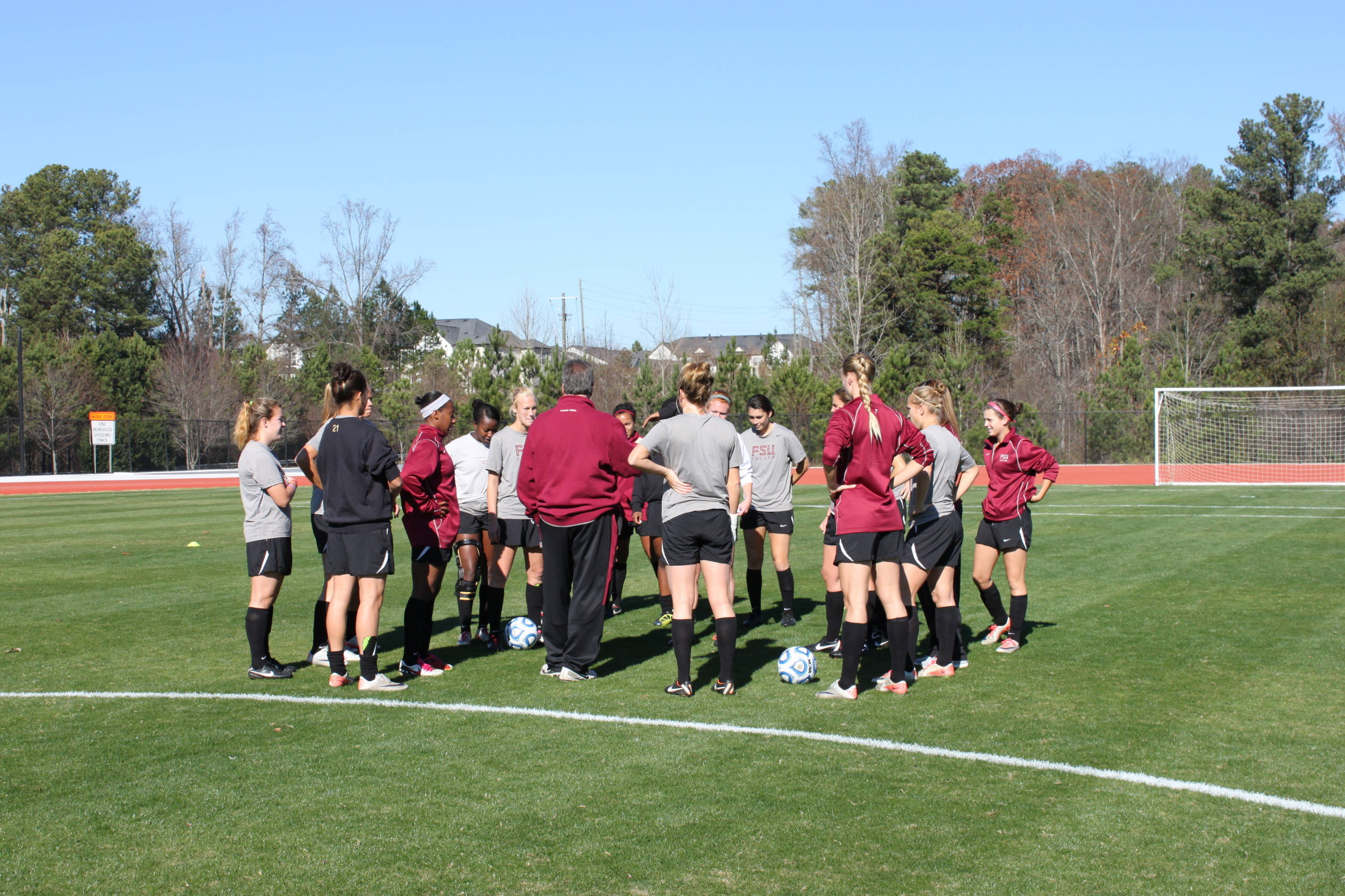 A quick team meeting during practice.