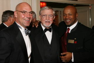 Former All-Pro Dick Anderson with the Executive Director of the College Football Coaches Association Grant Teaff  and Nebraska Heisman Trophy Winner Mike Rozier.