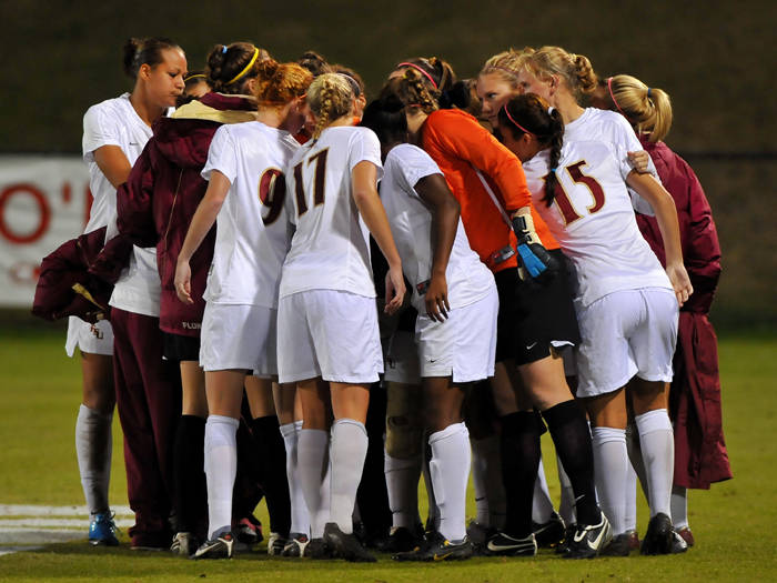The Seminoles huddle before the start of the second half.