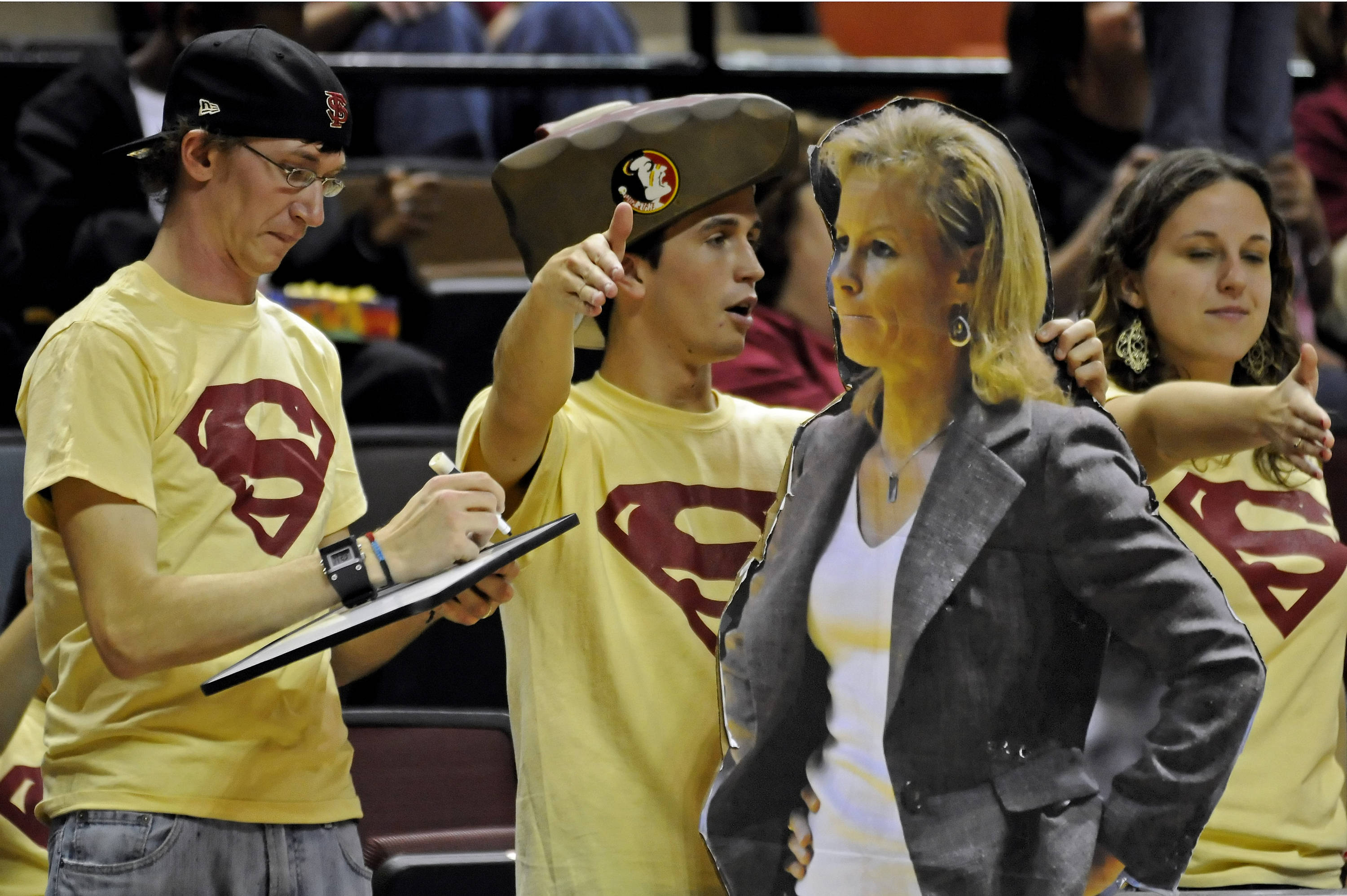 Sept. 6 ... Is that Coach Sue? Well, not really. That's a cutout made by the SUEper Fans as they showed their support last year during a game.