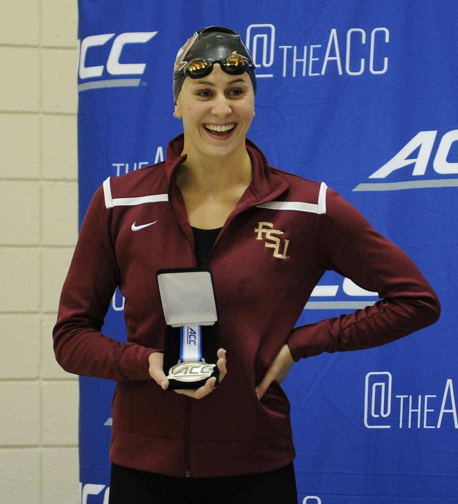 Chelsea Britt smiles after taking the silver in the 100 fly - Mitch White