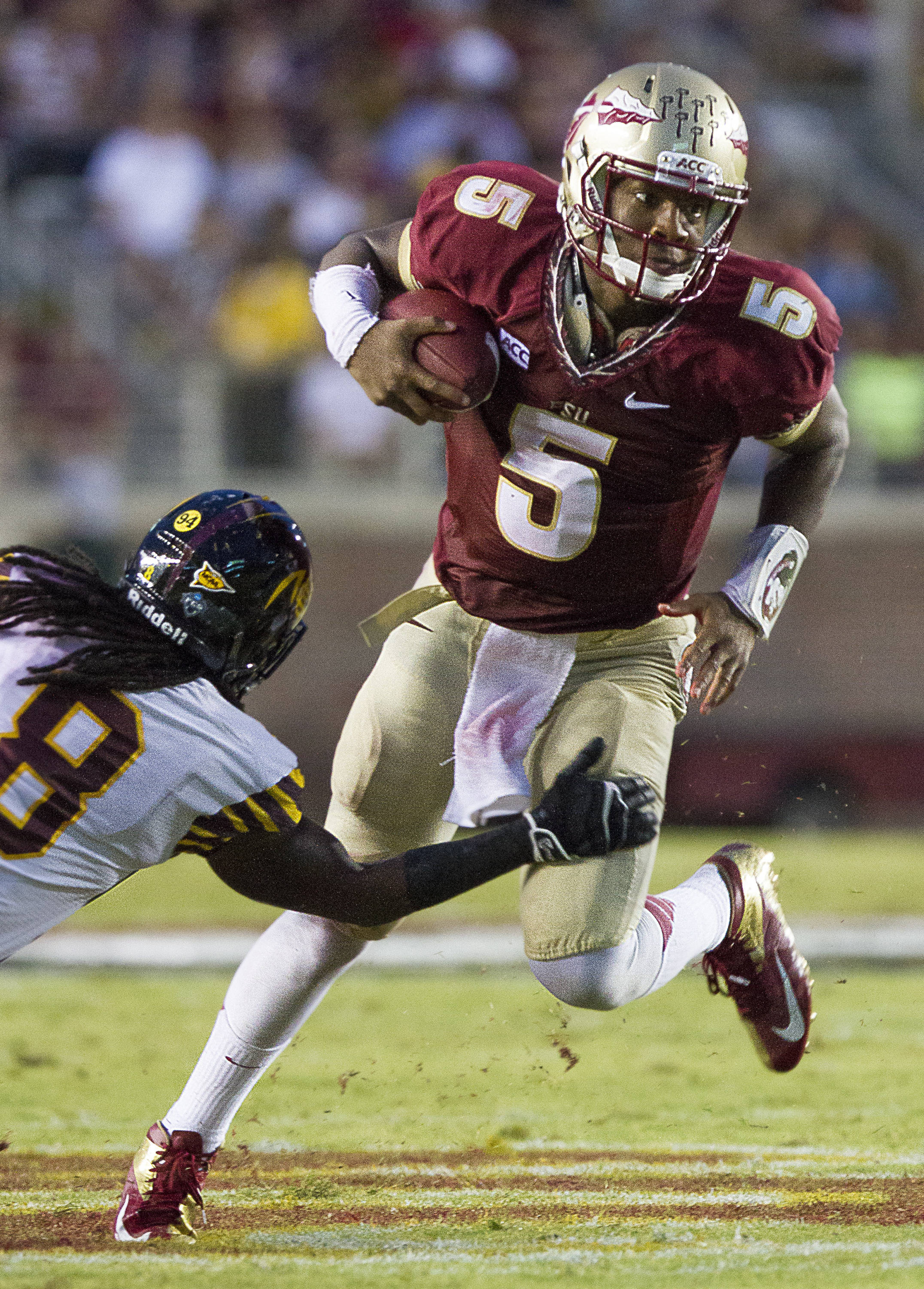 Jameis Winston (5) runs with the ball during FSU Football's 54-6 win over Bethune-Cookman on September 21, 2013 in Tallahassee, Fla