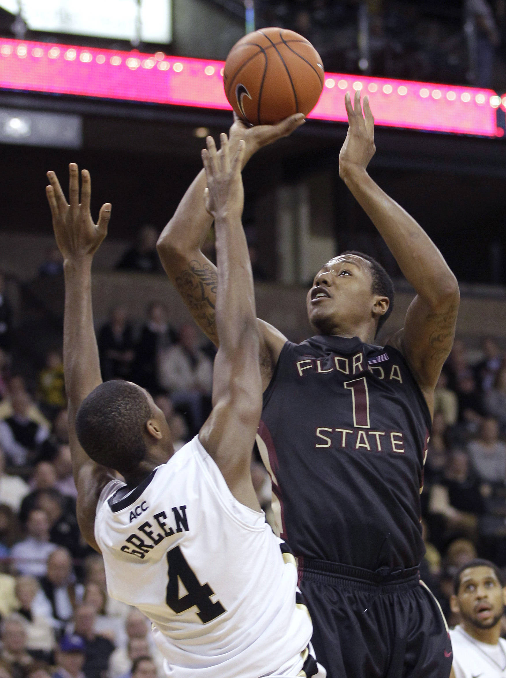 Florida State's Xavier Gibson shoots over Wake Forest's Daniel Green. (AP Photo/Chuck Burton)