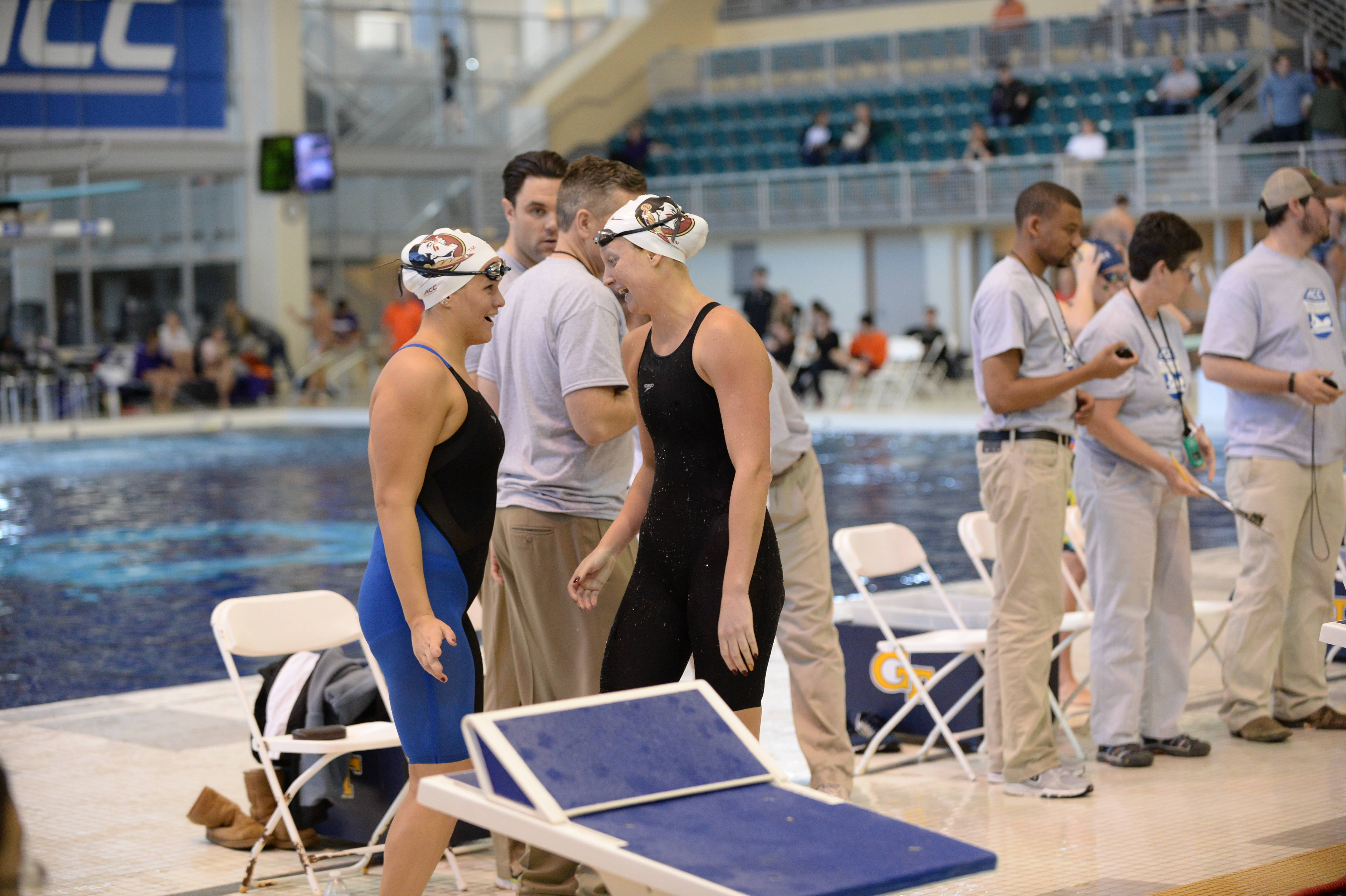 Bianca Spinazzola congratulates Haley Powell after swimming her best time - Mitch White